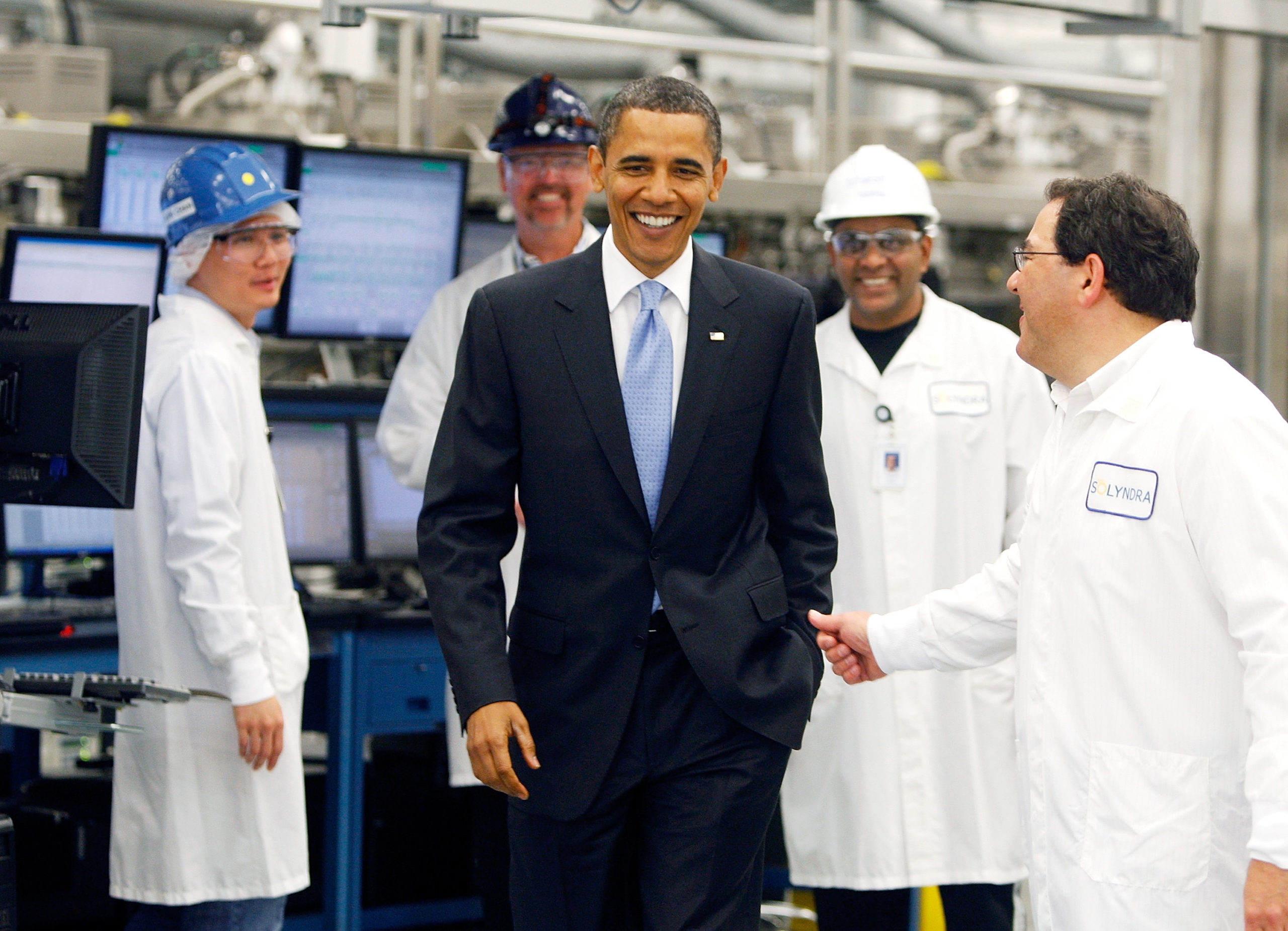 FREMONT, CA - MAY 26: U.S. President Barack Obama smiles during a tour of the Solyndra solar panel company May 26, 2010 in Fremont, California. President Obama toured Solyndra Inc., a growing solar power equipment facility that is adding jobs as they expand their operation. (Photo by Paul Chinn-Pool/Getty Images)