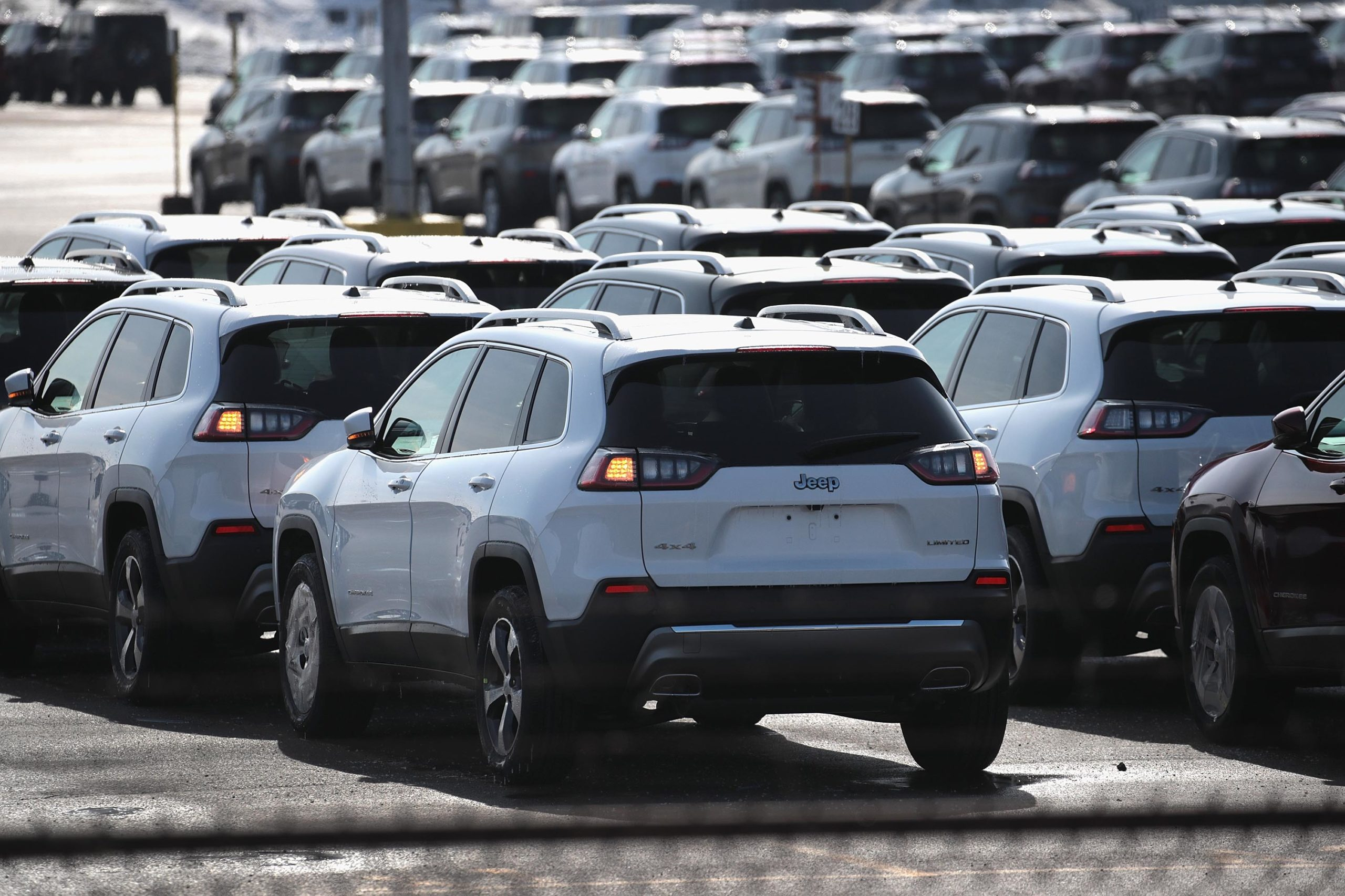 BELVIDERE, ILLINOIS - FEBRUARY 27: Jeep Cherokees sit on a lot at Fiat Chryslers's Belvidere Assembly Plant on February 27, 2019 in Belvidere, Illinois. Fiat Chrysler, the third-largest automaker in the U.S., has said it would lay off more than 1,300 of the 5,300 workers at the facility because of slowing sales for the Jeep Cherokee which is only built at the Belvidere plant. (Photo by Scott Olson/Getty Images)