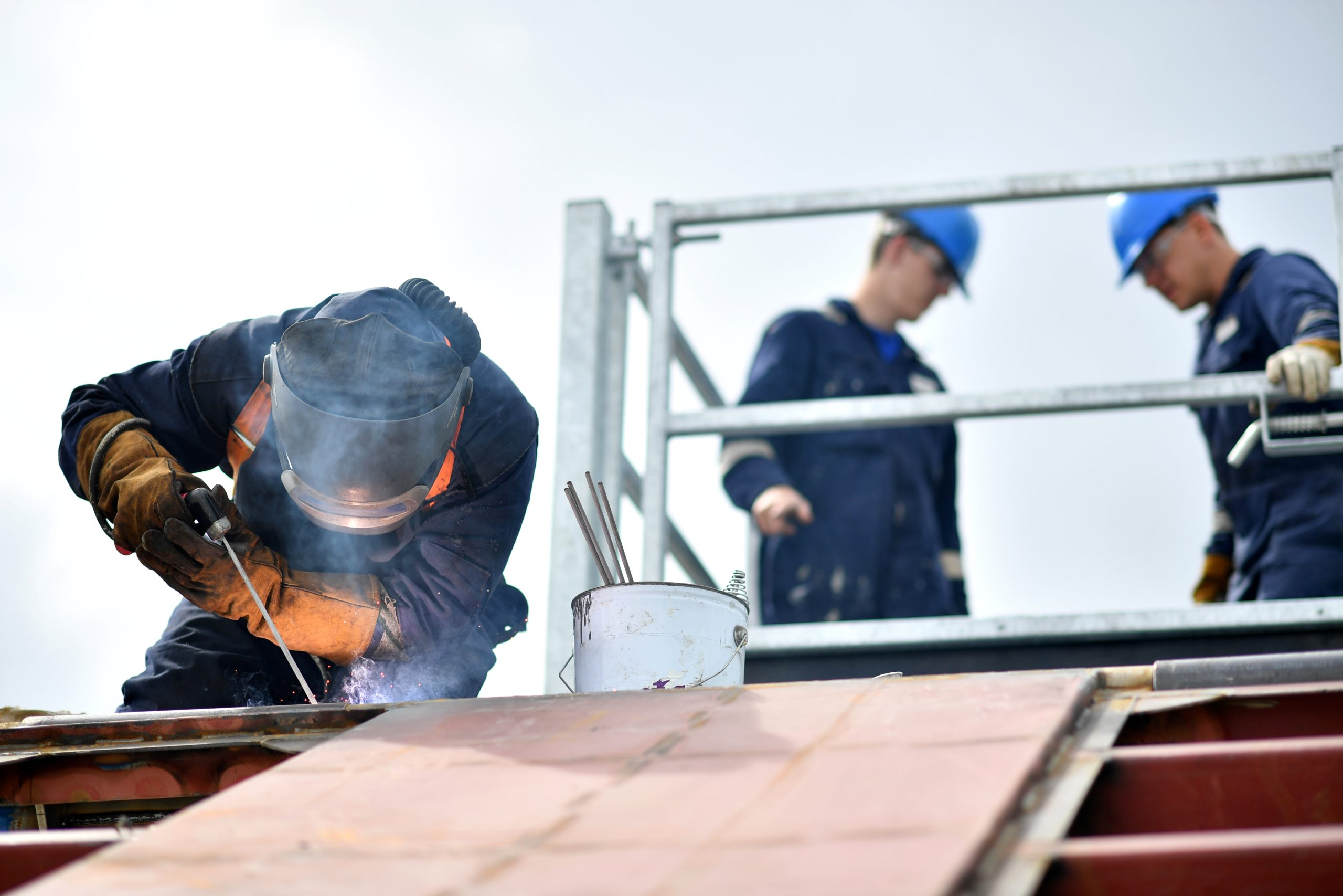 A welder works on a boat at Mainstay Marine Solutions' shipyard in Milford Haven in Wales on August 21, 2019. - Welsh businessman Stewart Graves is certain that a no-deal Brexit will shut down his marine renewable energy plant currently testing its prototypes in the Irish Sea.