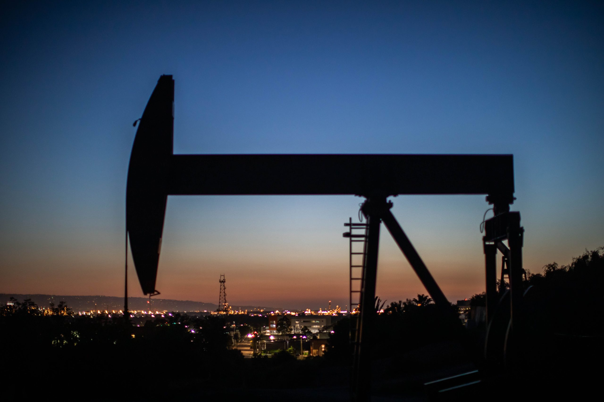 """An oil pumpjack operates at dusk Willow Springs Park in Long Beach, California on April 21, 2020, a day after oil prices dropped to below zero as the oil industry suffers steep falls in benchmark crudes due to the ongoing global coronavirus pandemic. - President Donald Trump on April 21 ordered his administration to come up with a plan to aid US oil companies struggling with a massive supply glut and record-low crude prices. """"We will never let the great US Oil & Gas Industry down,"""" Trump tweeted. (Photo by Apu GOMES / AFP) (Photo by APU GOMES/AFP via Getty Images)"""
