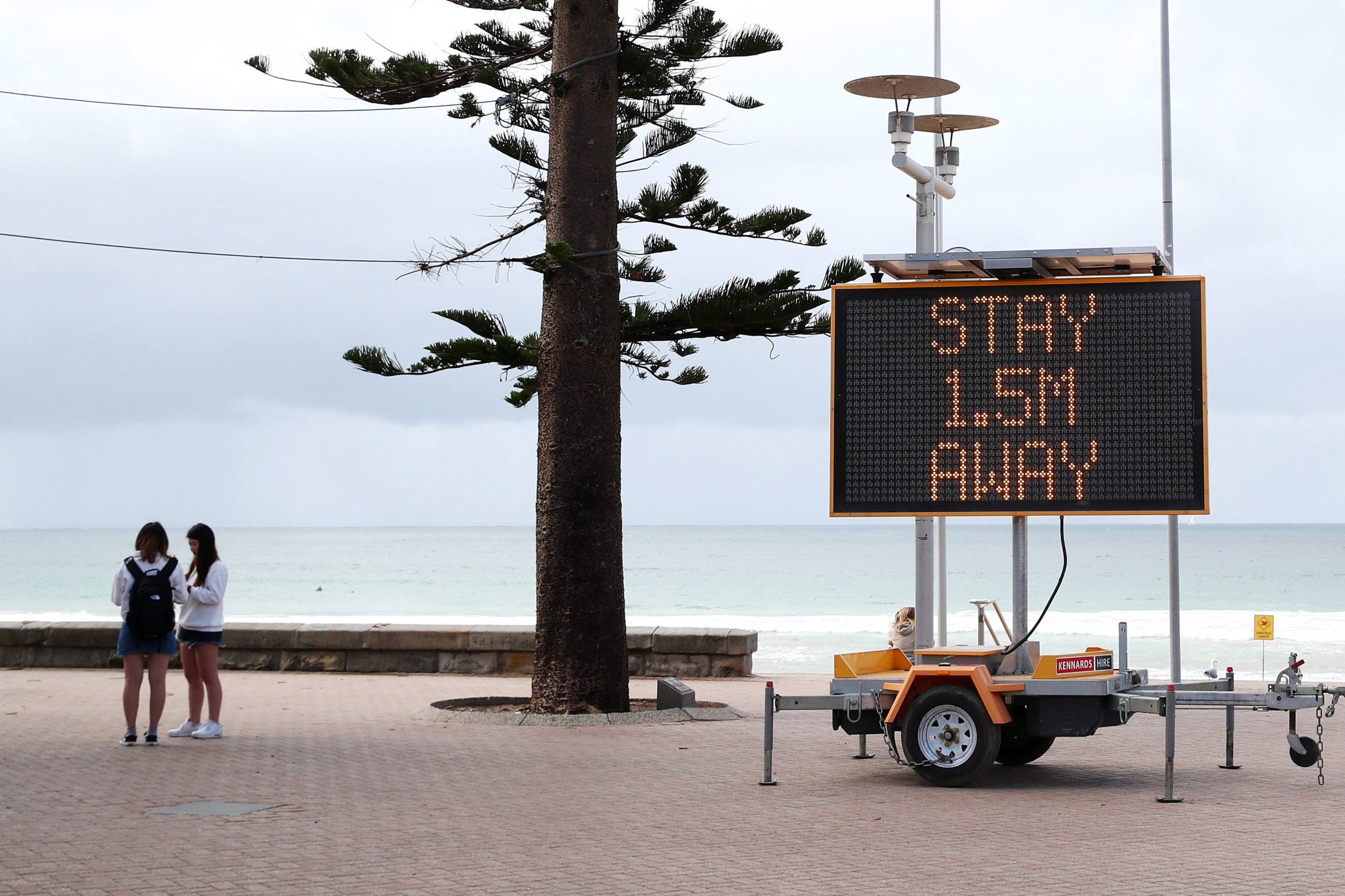 A sign in Australia urges citizens to stay 1.5 meters, or about 5 feet, apart in 2020. (Cameron Spencer/Getty Images)
