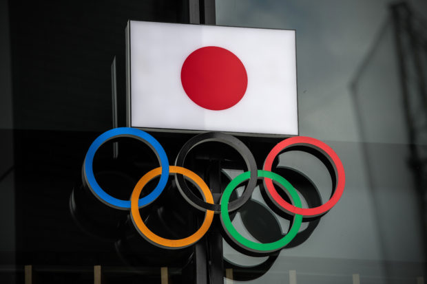 The Japanese flag is displayed over the Olympic Rings on October 13, 2020 in Tokyo, Japan. (Photo by Carl Court/Getty Images)