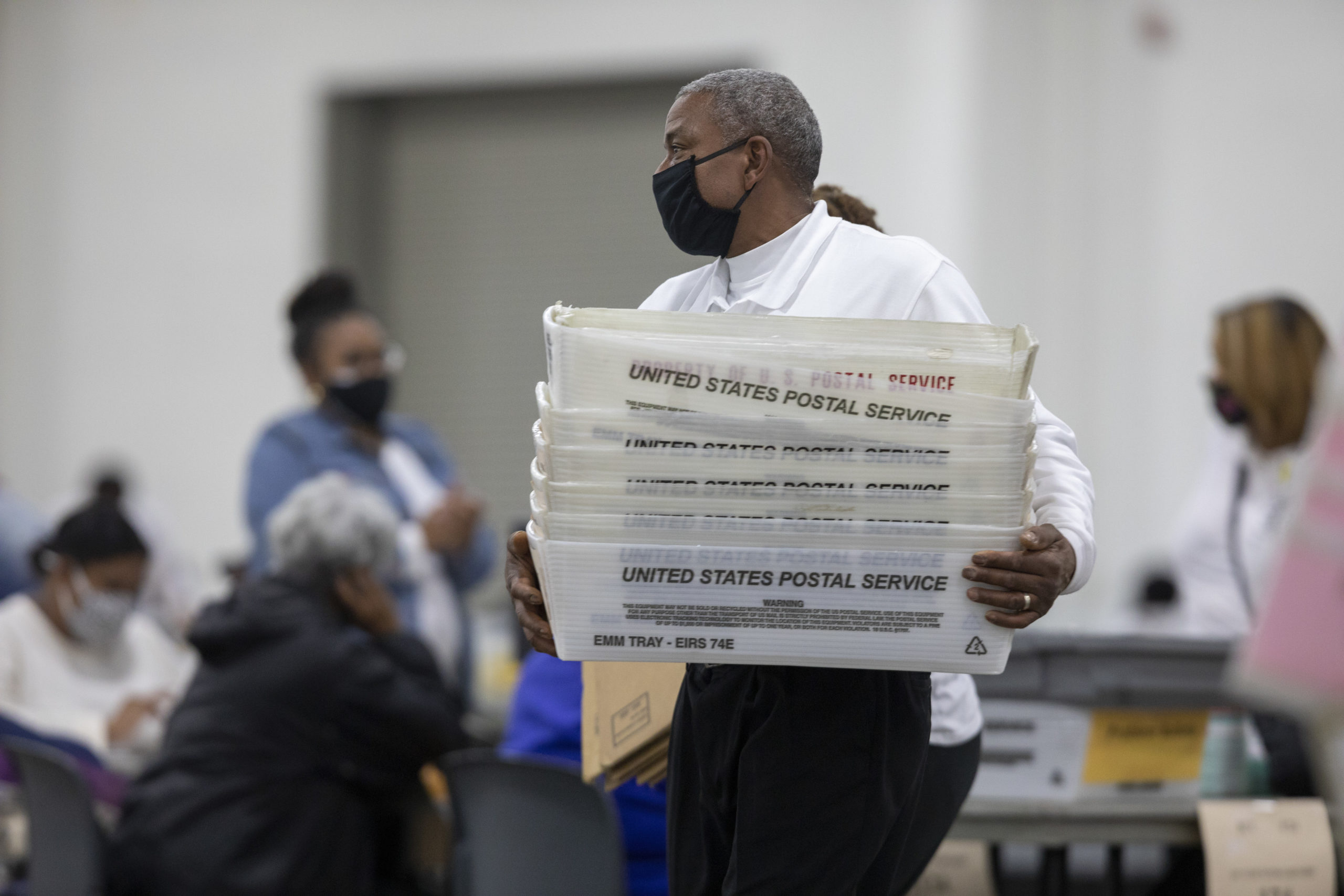 DETROIT, MI - NOVEMBER 04: A worker with the Detroit Department of Elections carries empty boxes used to organize absentee ballots after nearing the end of the absentee ballot count at the Central Counting Board in the TCF Center on November 4, 2020 in Detroit, Michigan. President Trump narrowly won Michigan in 2016, and both he and Joe Biden campaigned heavily in the battleground state in 2020. (Photo by Elaine Cromie/Getty Images)