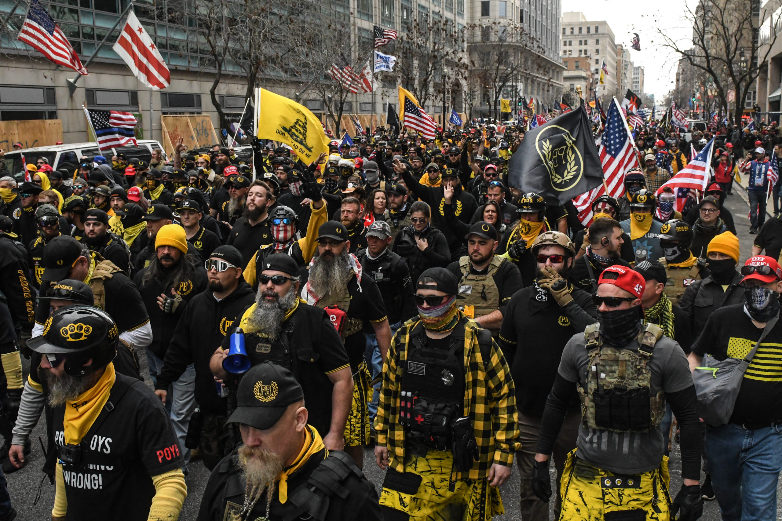 Members of the Proud Boys march towards Freedom Plaza during a protest on December 12, 2020 in Washington, DC. Thousands of protesters who refuse to accept that President-elect Joe Biden won the election are rallying ahead of the electoral college vote to make Trump's 306-to-232 loss official. (Photo by Stephanie Keith/Getty Images)