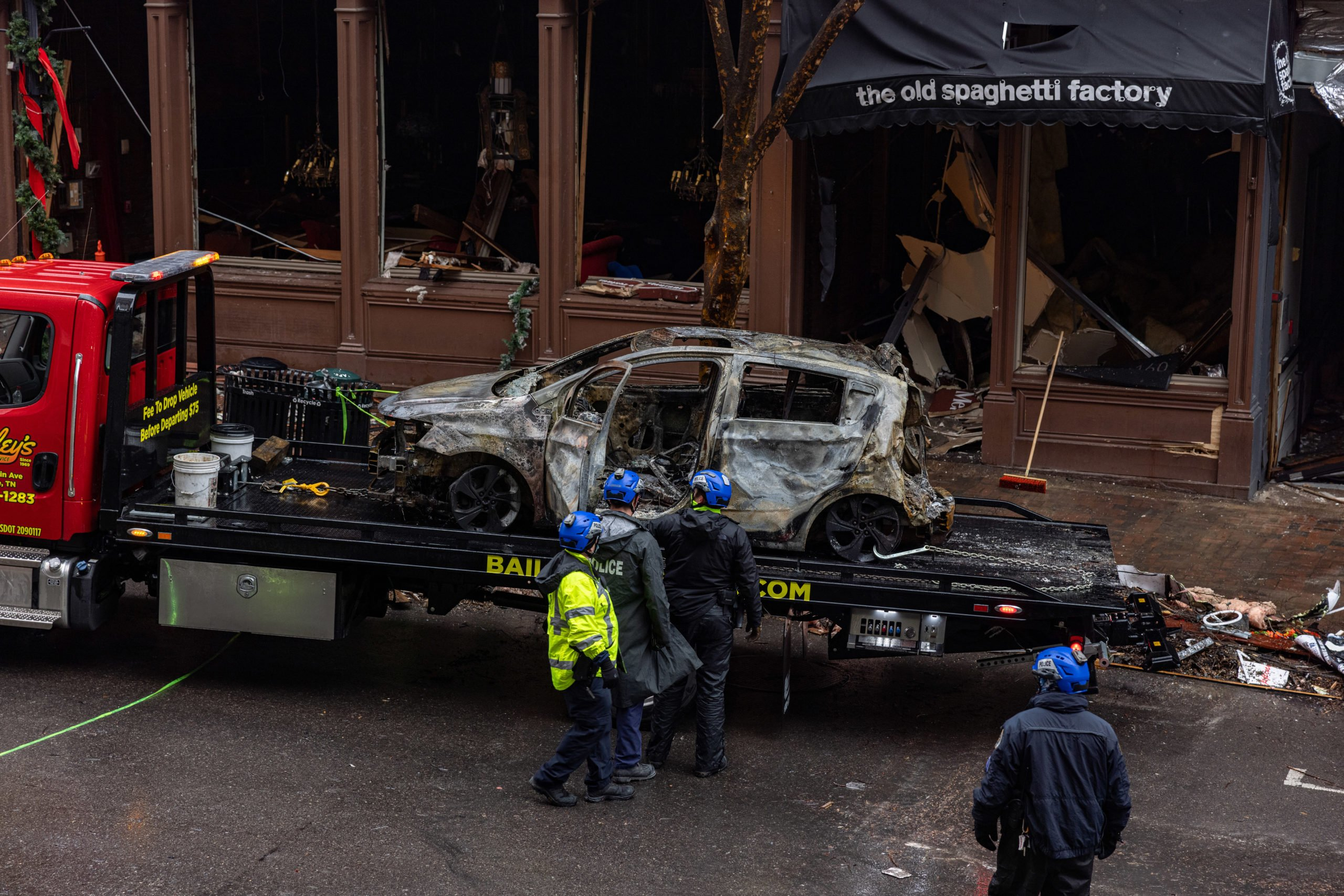 NASHVILLE, TN - DECEMBER 31: MNPD inspects the inside of an incinerated vehicle before it is towed from Second Avenue on Decemeber 31, 2020 in Nashville, TN. On Christmas morning, suspect Anthony Warner detonated an R.V. packed with explosives in Downtown Nashville damaging over forty buildings in Nashville's Historic District. (Photo by Alex Kent/Getty Images)
