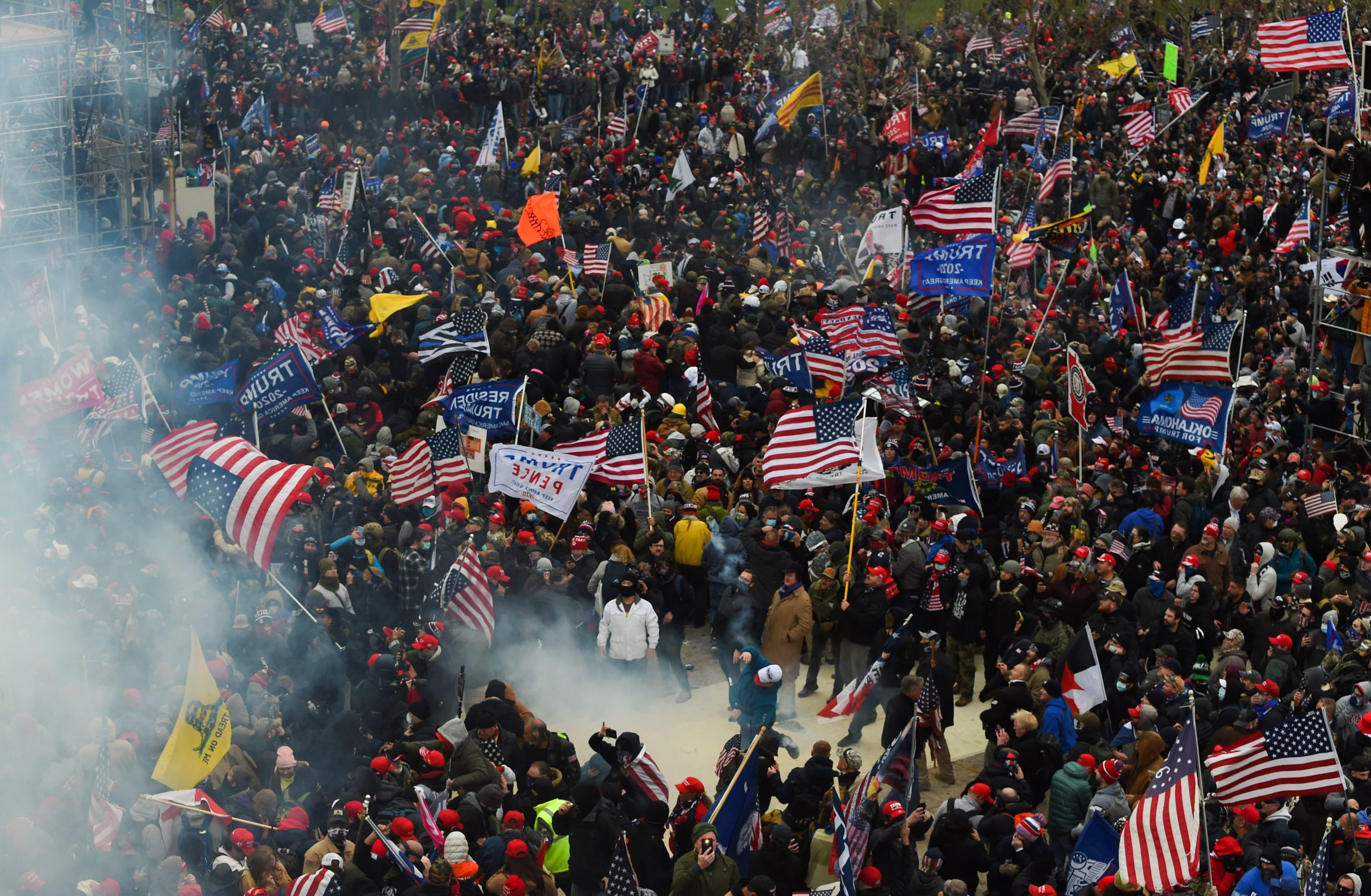 Trump supporters clash with police and security forces as they storm the US Capitol in Washington D.C on January 6, 2021. - Demonstrators breeched security and entered the Capitol as Congress debated the a 2020 presidential election Electoral Vote Certification. (Photo by Roberto Schmidt/AFP via Getty Images)