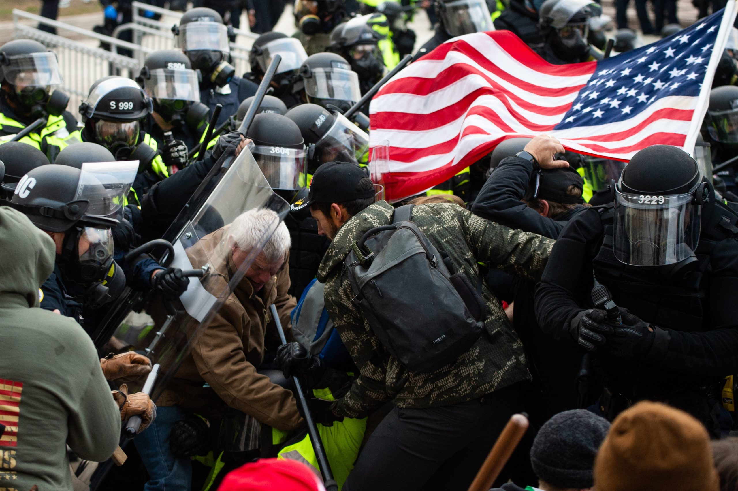 Supporters of US President Donald Trump fight with riot police outside the Capitol building on January 6, 2021 in Washington, DC. (ROBERTO SCHMIDT/AFP via Getty Images)