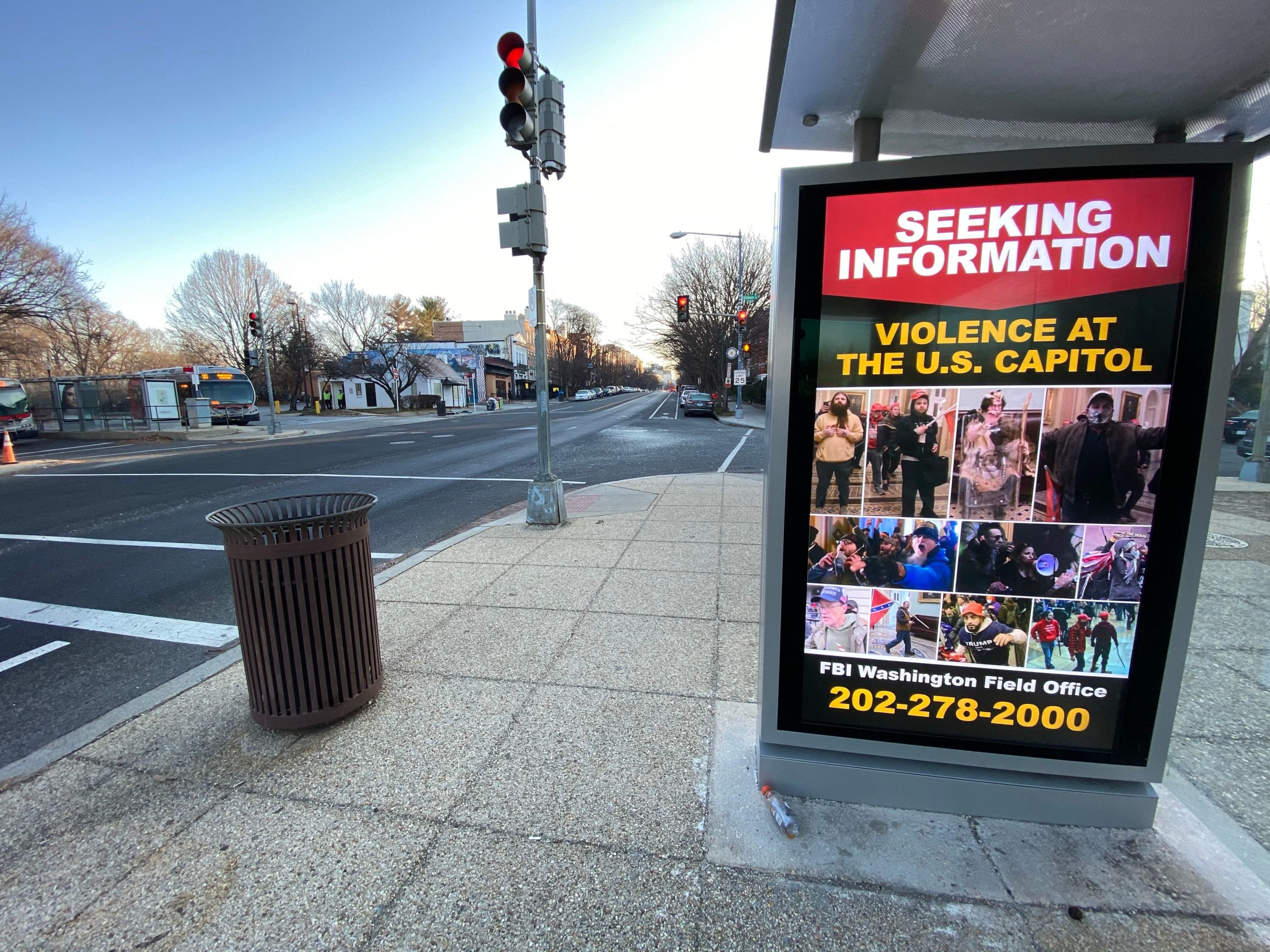 A poster distributed by the FBI seeking information on Capitol rioters is seen displayed at a bus stop kiosk in Washington, D.C. on Jan. 13. (Eric Baradat/AFP via Getty Images)