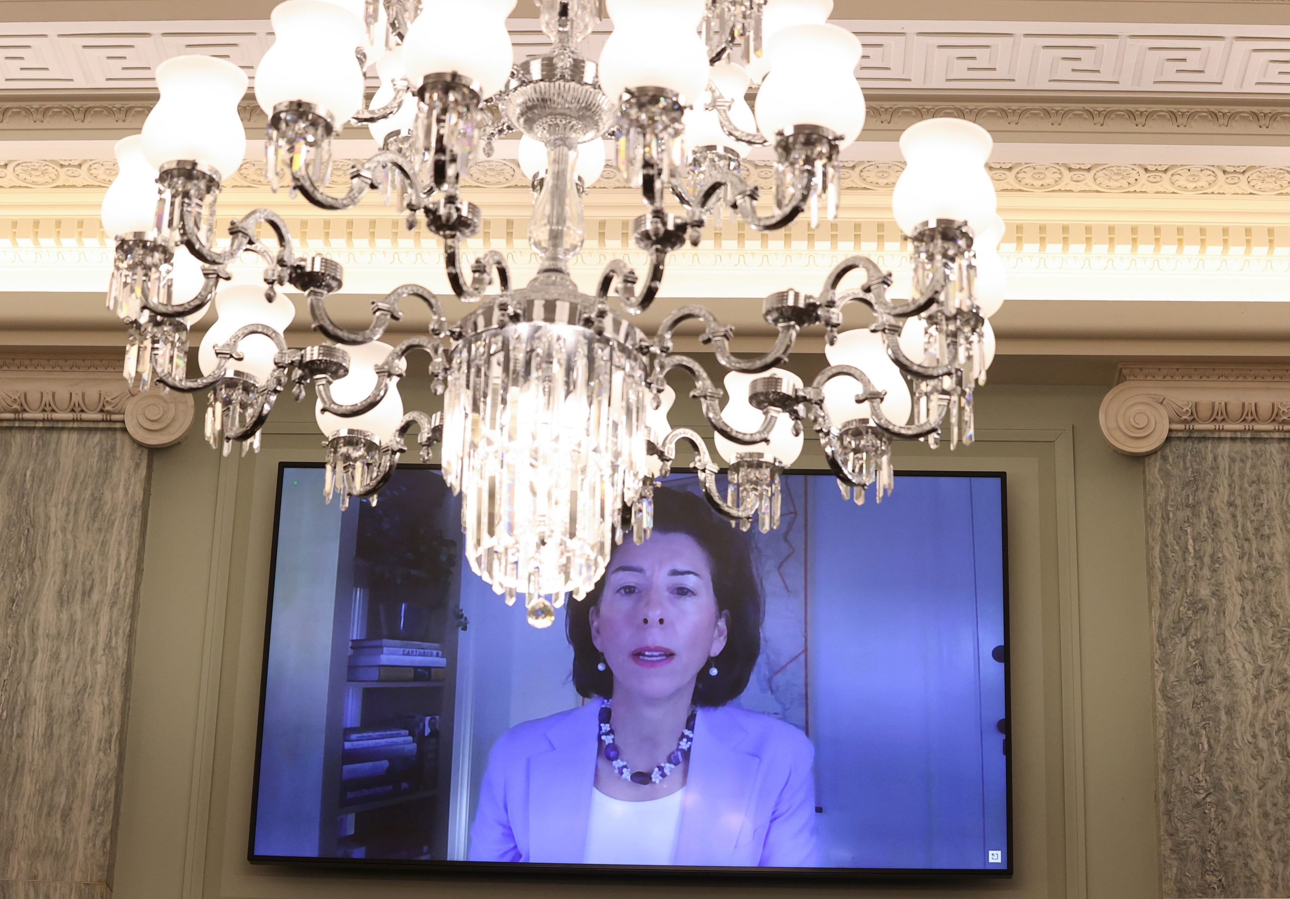Sec. Gina Raimondo is seen testifying remotely during her Senate confirmation hearing on Jan. 26. (Jonathan Ernst/Pool/AFP via Getty Images)