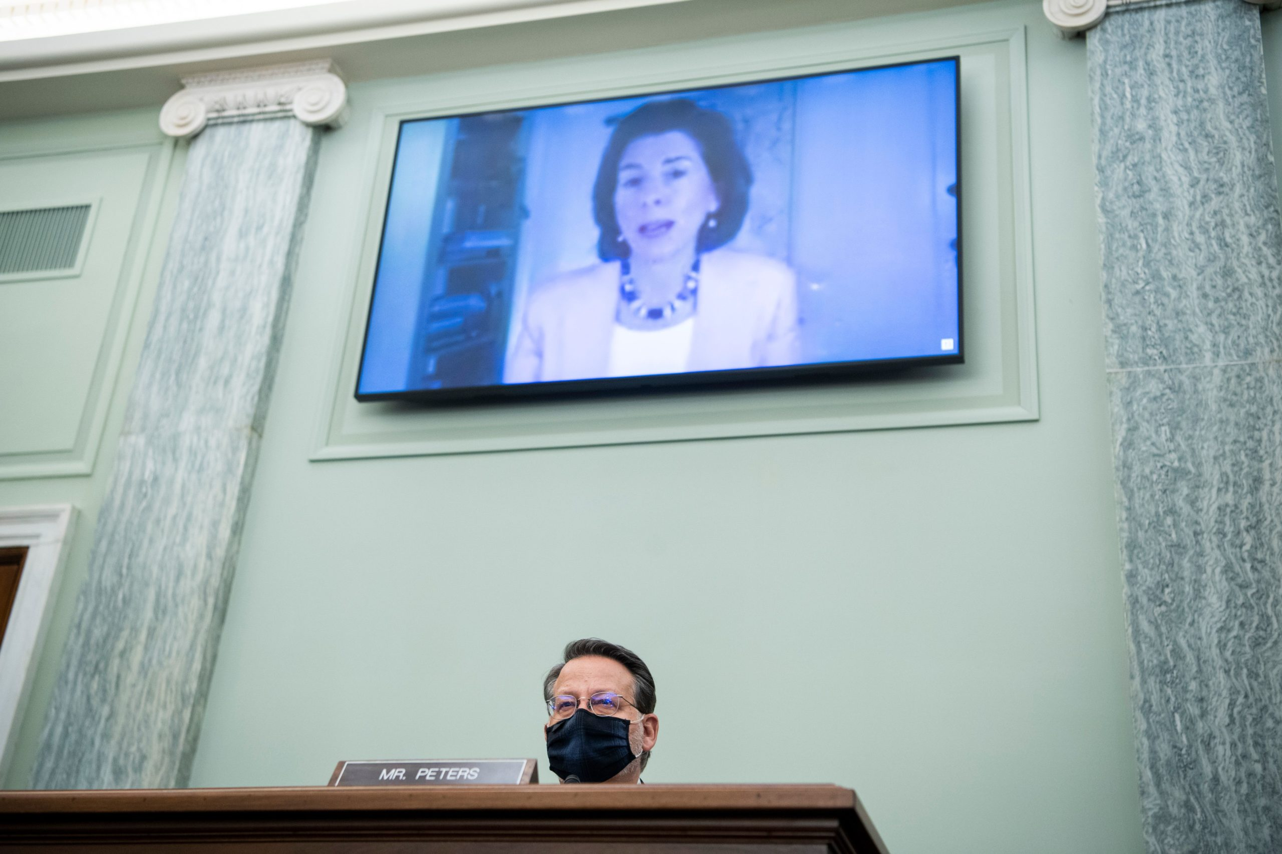 Sen. Gary Peters questions Gina Raimondo during her Senate confirmation hearing in January. (Tom Williams/Pool/AFP via Getty Images)