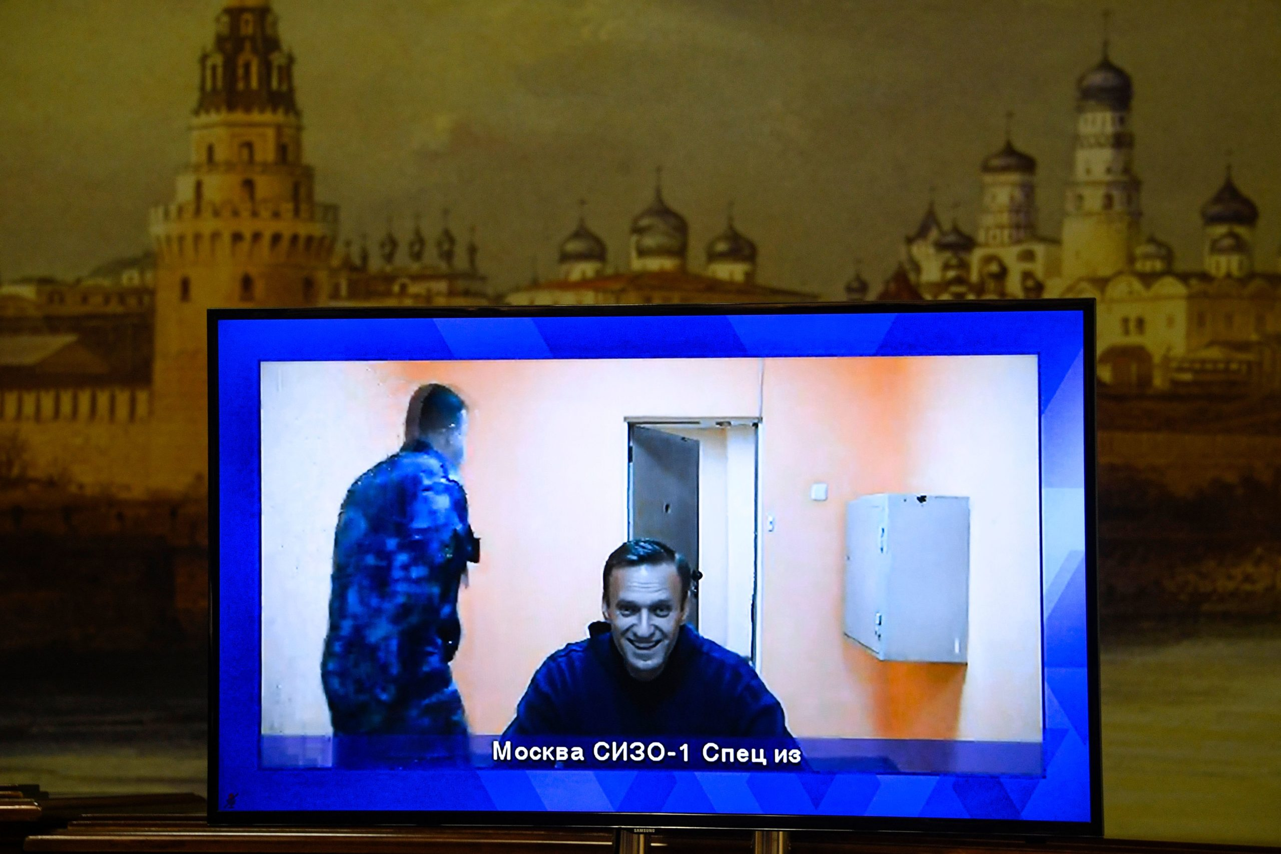Opposition leader Alexei Navalny appears on a screen set up at a hall of the Moscow Regional Court via a video link from Moscow's penal detention centre Number 1 (known as Matrosskaya Tishina) during a court hearing of an appeal against his arrest, in Krasnogorsk outside Moscow on January 28, 2021. - Navalny, 44, was detained on January 17 upon returning to Moscow after five months in Germany recovering from a near-fatal poisoning with a nerve agent and later jailed for 30 days while awaiting trial for violating a suspended sentence he was handed in 2014. (Photo by Alexander NEMENOV / AFP) (Photo by ALEXANDER NEMENOV/AFP via Getty Images)