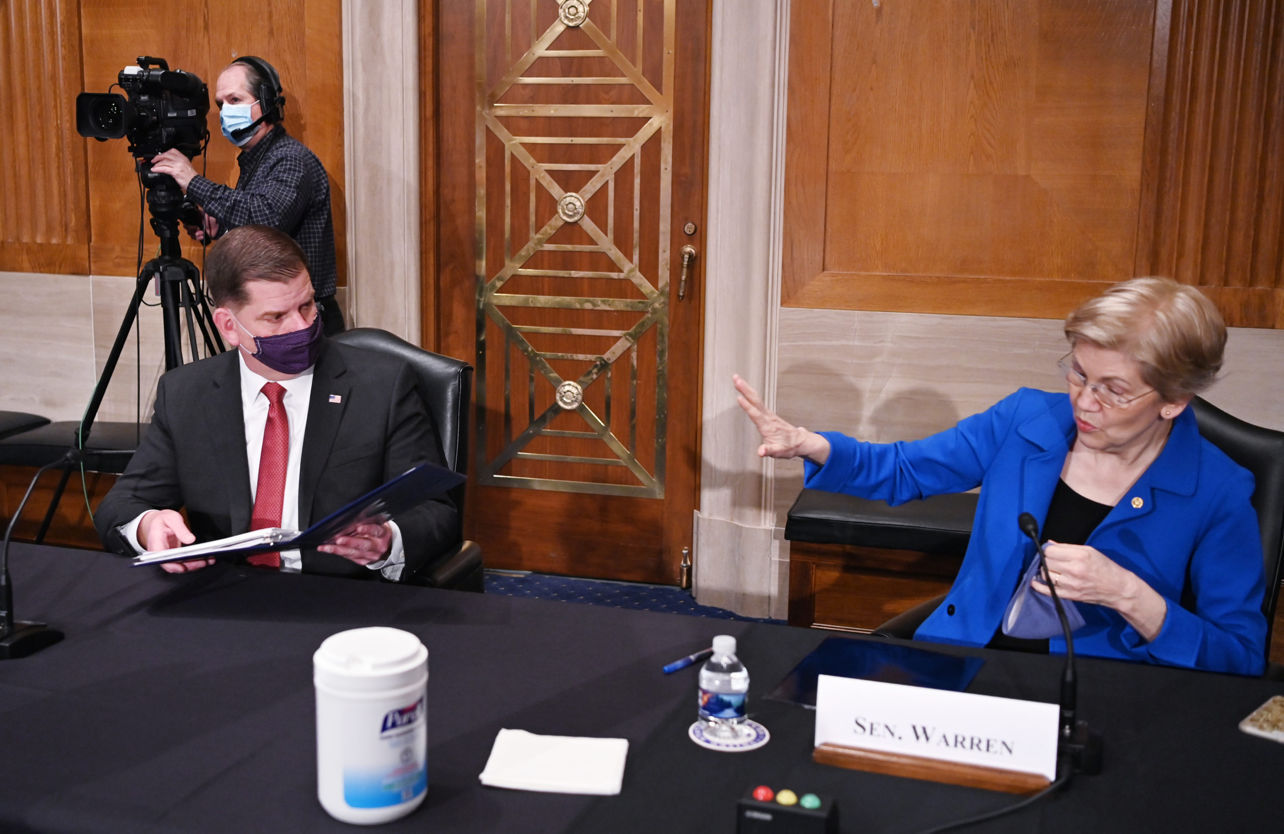 Sen. Elizabeth Warren and Marty Walsh arrive at his confirmation hearing on Feb. 4. (Mandel Ngan/Pool/Getty Images)