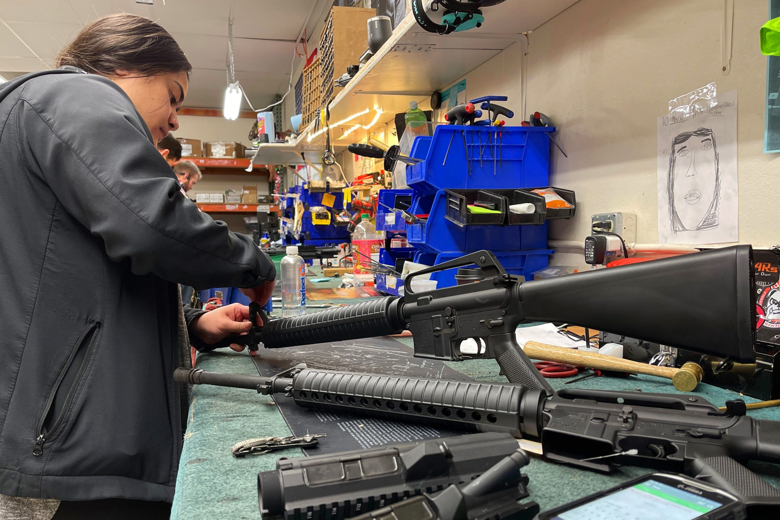 A worker assembles AR-15 style rifles at Davidson Defense in Orem, Utah on February 4, 2021. - Gun merchants sold more than 2 million firearms in January, a 75% increase over the estimated 1.2 million guns sold in January 2020, according to the National Shooting Sports Federation, a firearms industry trade group. The FBI said it conducted a record 4.3 million background checks in January. If that pace continues, the bureau will complete more than 50 million gun-related background checks by the end of the year, shattering the current record set in 2020, according to a new report from Bespoke Investment Group. (Photo by GEORGE FREY / AFP) (Photo by GEORGE FREY/AFP via Getty Images)