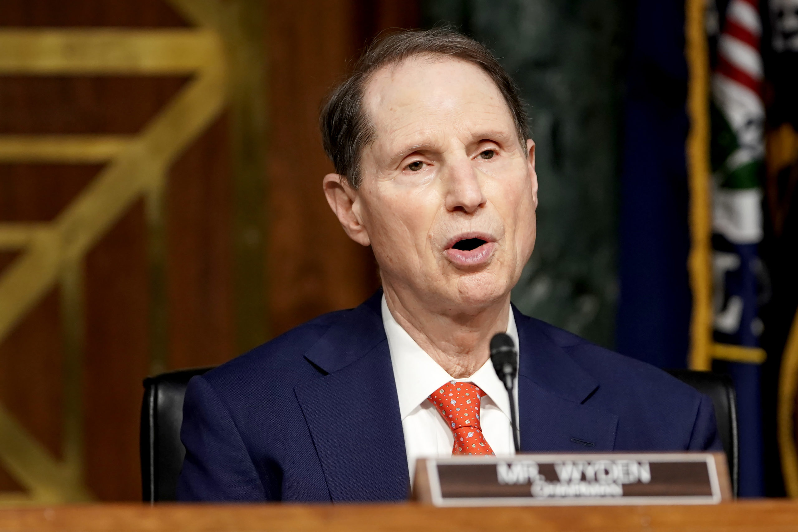 Senate Finance Committee Chairman Ron Wyden makes an opening statement during a nomination hearing for Xavier Becerra on Feb. 24. (Greg Nash/Pool/Getty Images)