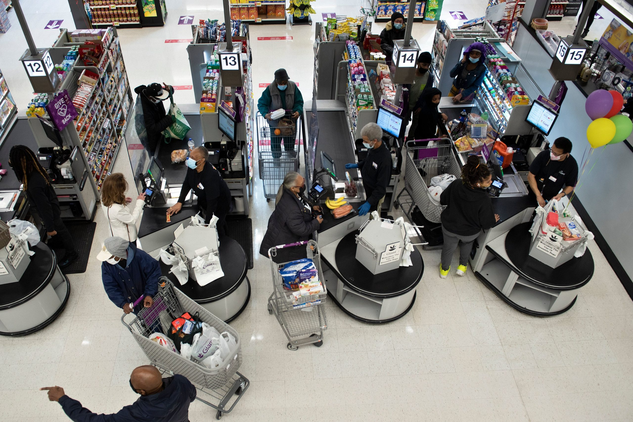 People shop at a grocery store in February in Washington, D.C. (Brendan Smialowski/AFP via Getty Images)