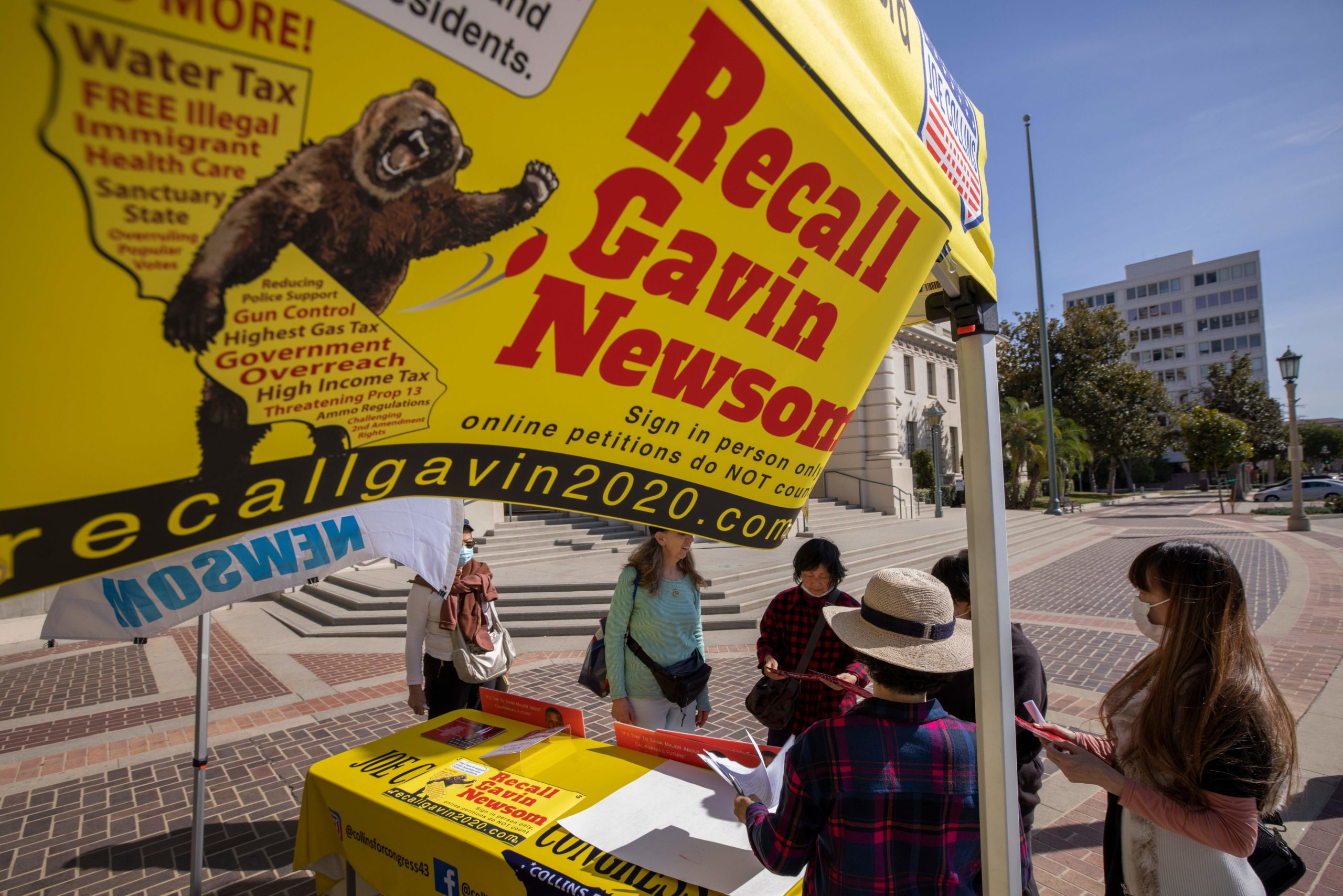 Conservative activists gather signatures in a recall effort against California Governor Gavin Newsom near Pasadena City Hall, in Pasadena, California on February 28, 2021. (DAVID MCNEW/AFP via Getty Images)