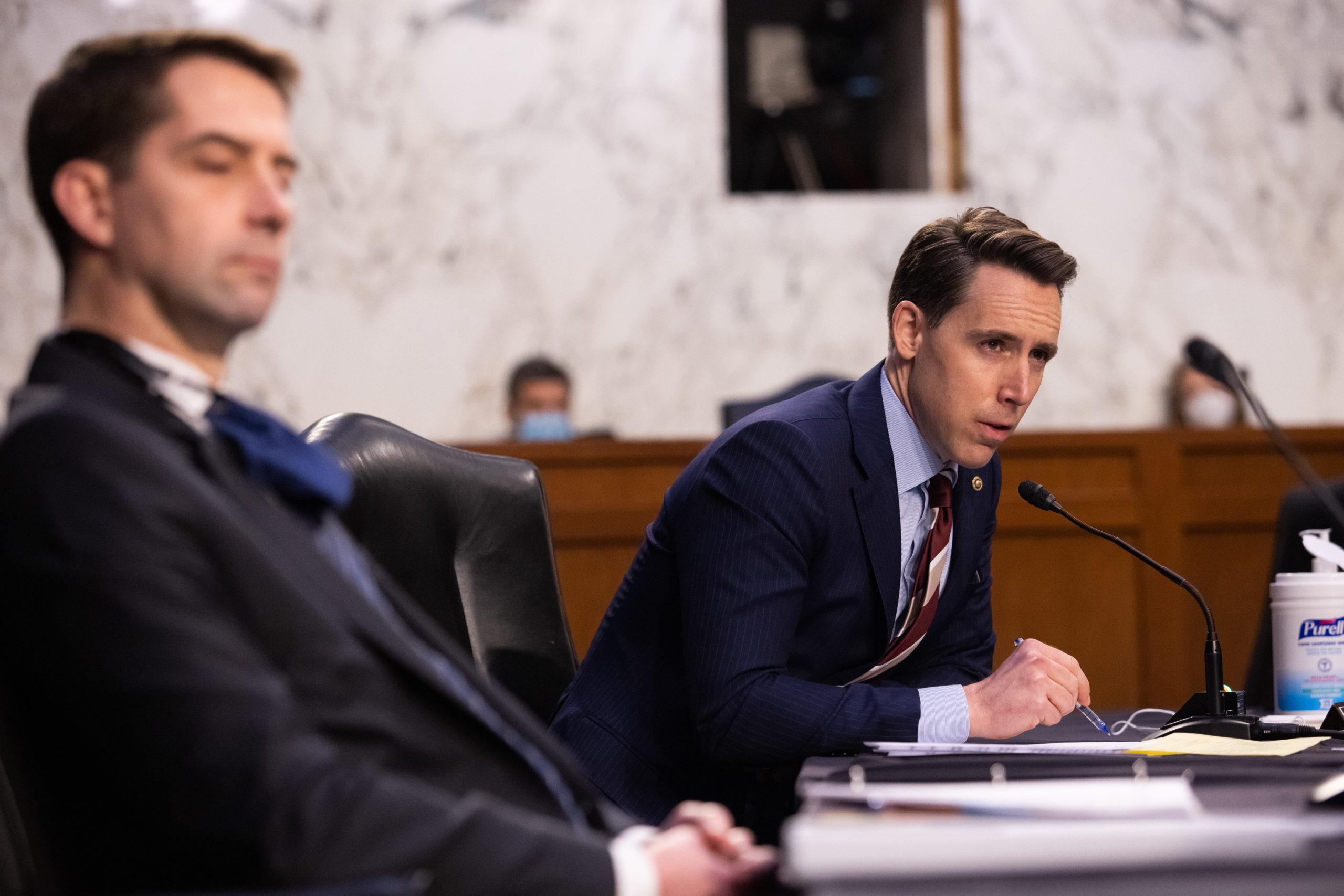 Sen. Josh Hawley speaks during a Senate Judiciary Committee on March 2, 2021. Sen. Tom Cotton looks on. (Graeme Jennings-Pool/Getty Images)