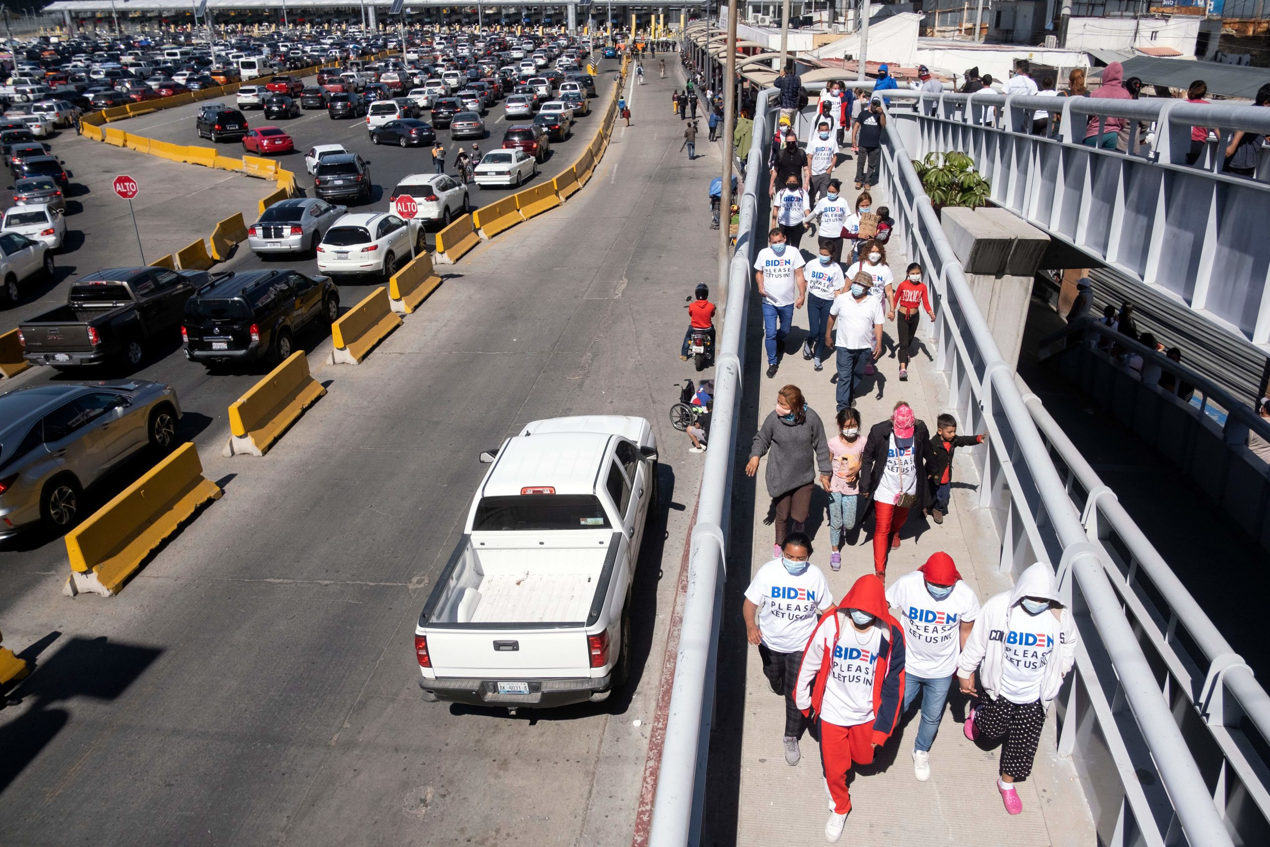 Migrants hold a demonstration demanding clearer United States migration policies, at San Ysidro crossing port in Tijuana, Baja California state, Mexico on March 2, 2021. - Thousands of migrants out of the Migrant Protection Protocol (MPP) program are stranded along the US-Mexico border without knowing when or how they will be able to start their migratory process with US authorities. (Photo by Guillermo Arias / AFP) (Photo by GUILLERMO ARIAS/AFP via Getty Images)