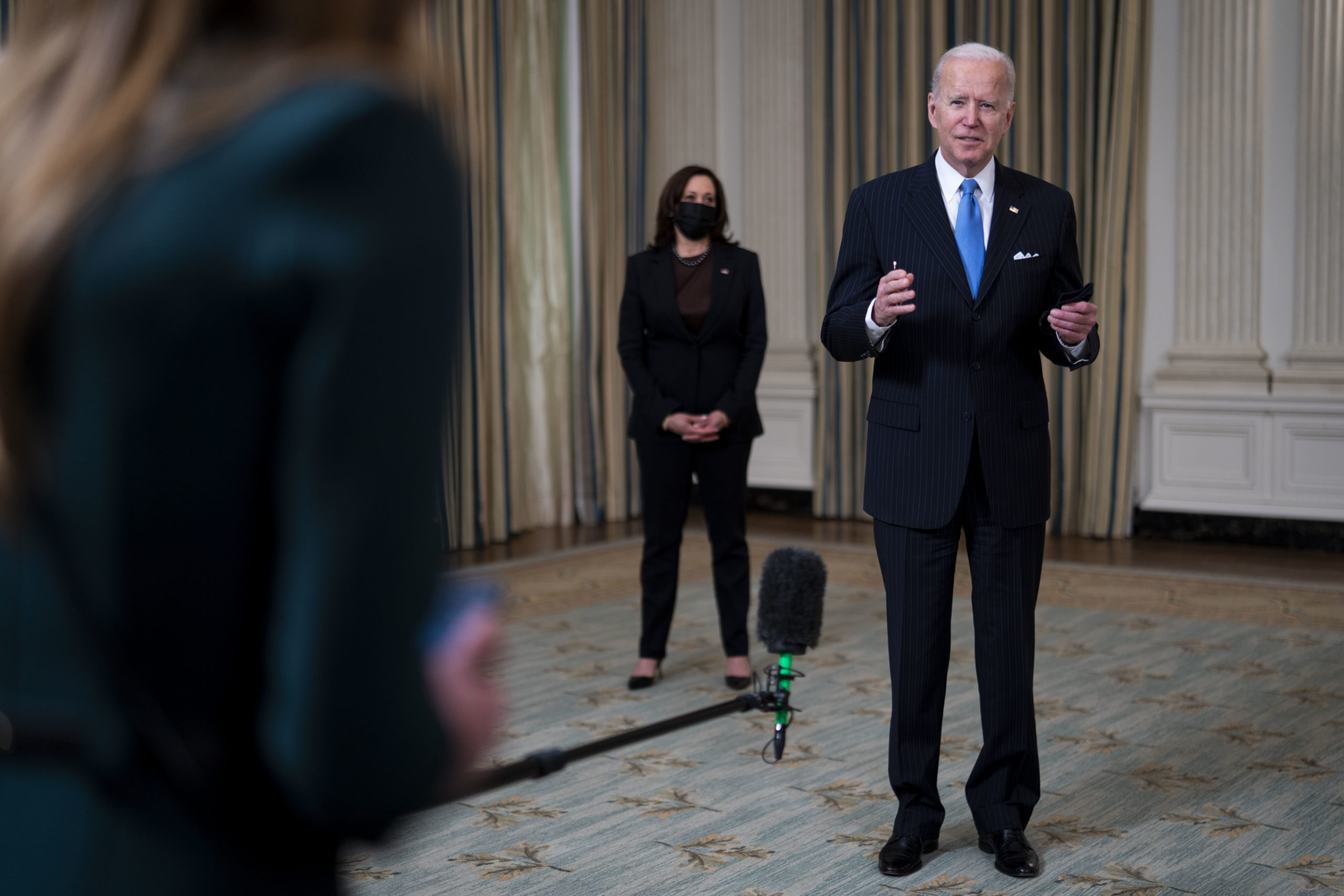 WASHINGTON, DC - MARCH 2: U.S. President Joe Biden briefly speaks to reporters after delivering remarks in the State Dining Room of the White House on March 2, 2021 in Washington, DC. President Biden spoke about the recently announced partnership between Johnson & Johnson and Merck to produce more J&J COVID-19 vaccine. (Photo by Doug Mills-Pool/Getty Images)