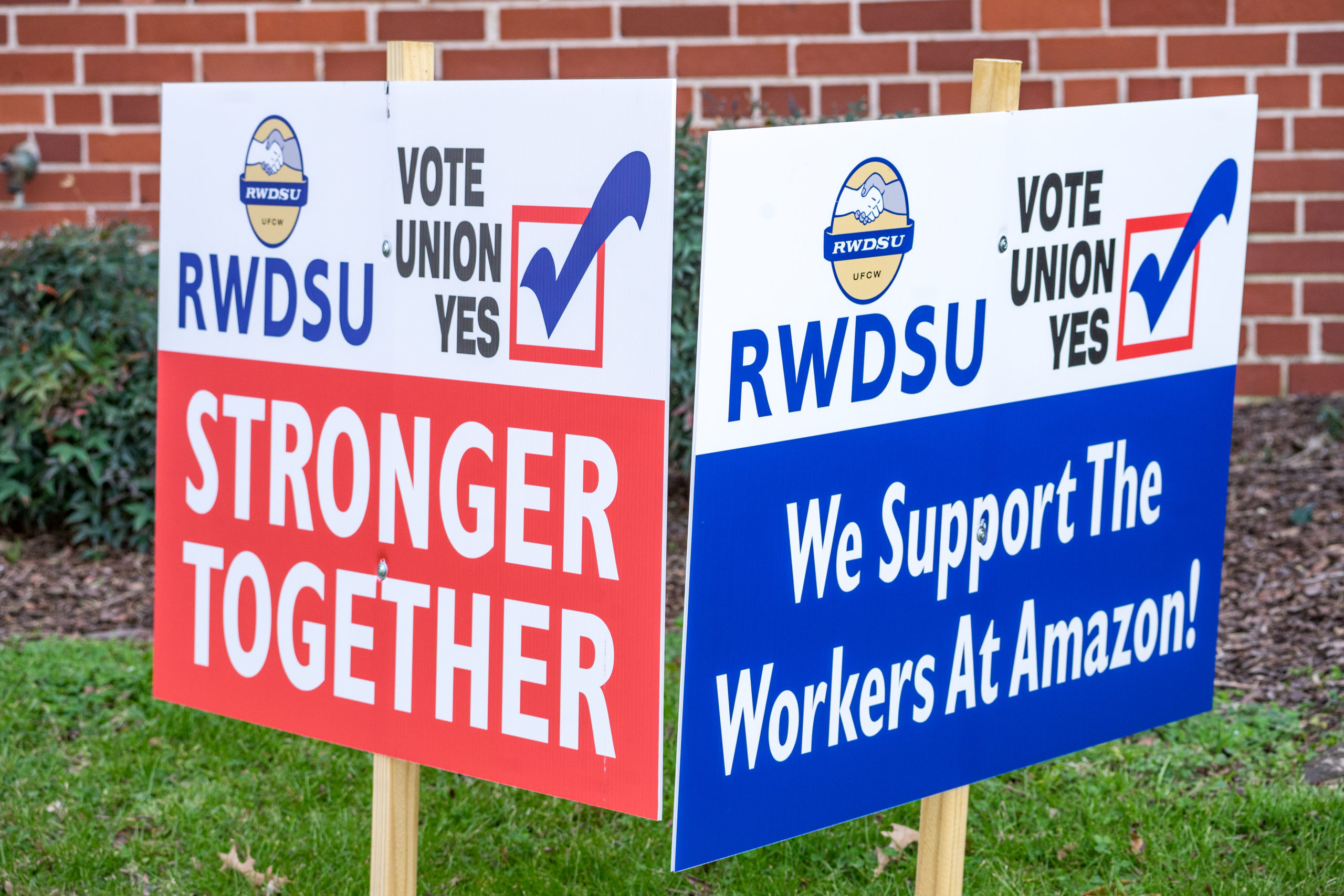 Pro-unionization signs are pictured on March 5 outside of Amazon's Bessemer, Alabama facility. (Megan Varner/Getty Images)