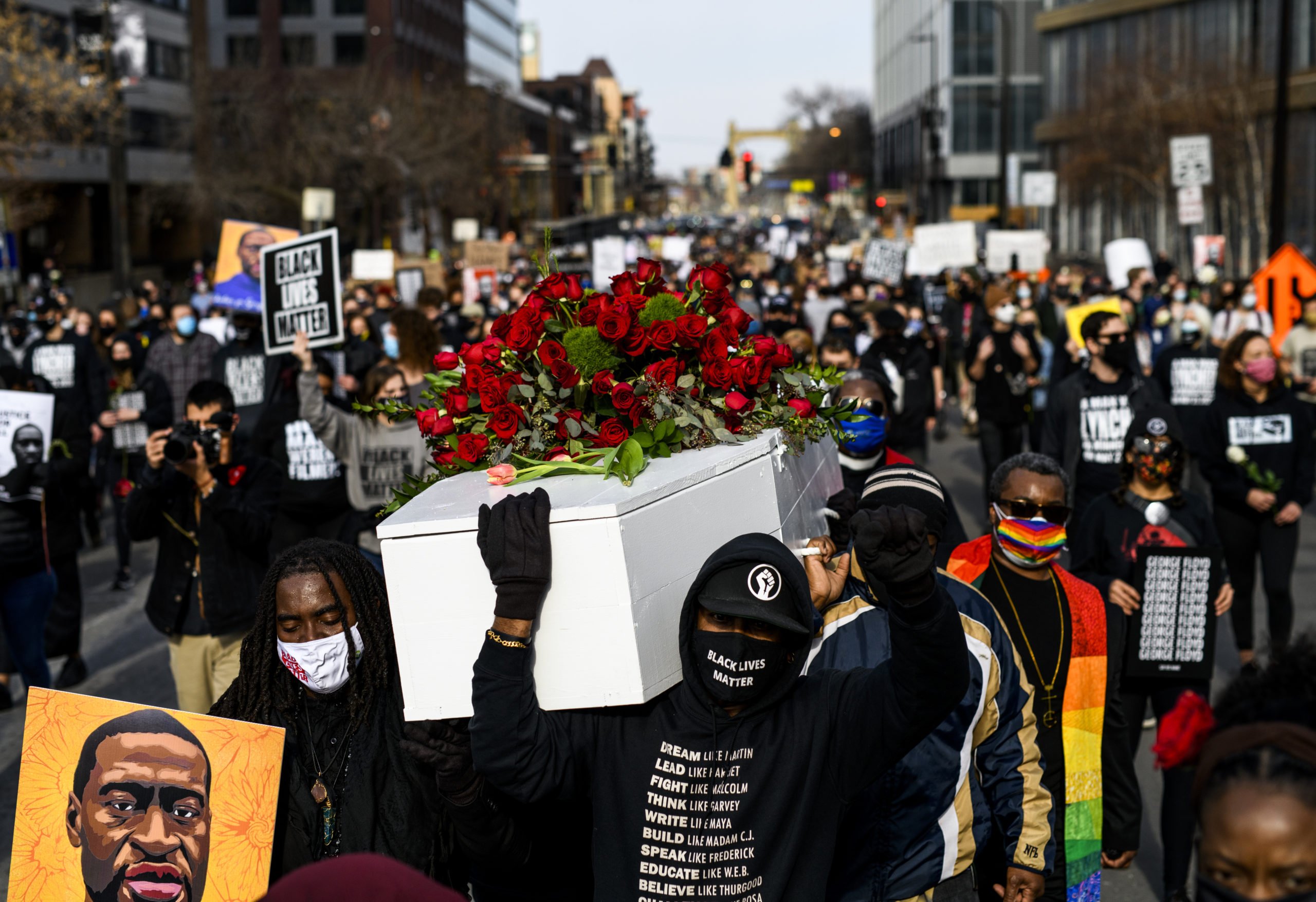 MINNEAPOLIS, MN - MARCH 7: People carry a casket covered in roses during a march in honor of George Floyd on March 7, 2021 in Minneapolis, Minnesota. Jury selection in the trial of former Minneapolis Police Officer Derek Chauvin, who is accused of killing Floyd, starts on Monday, March 8. (Photo by Stephen Maturen/Getty Images)