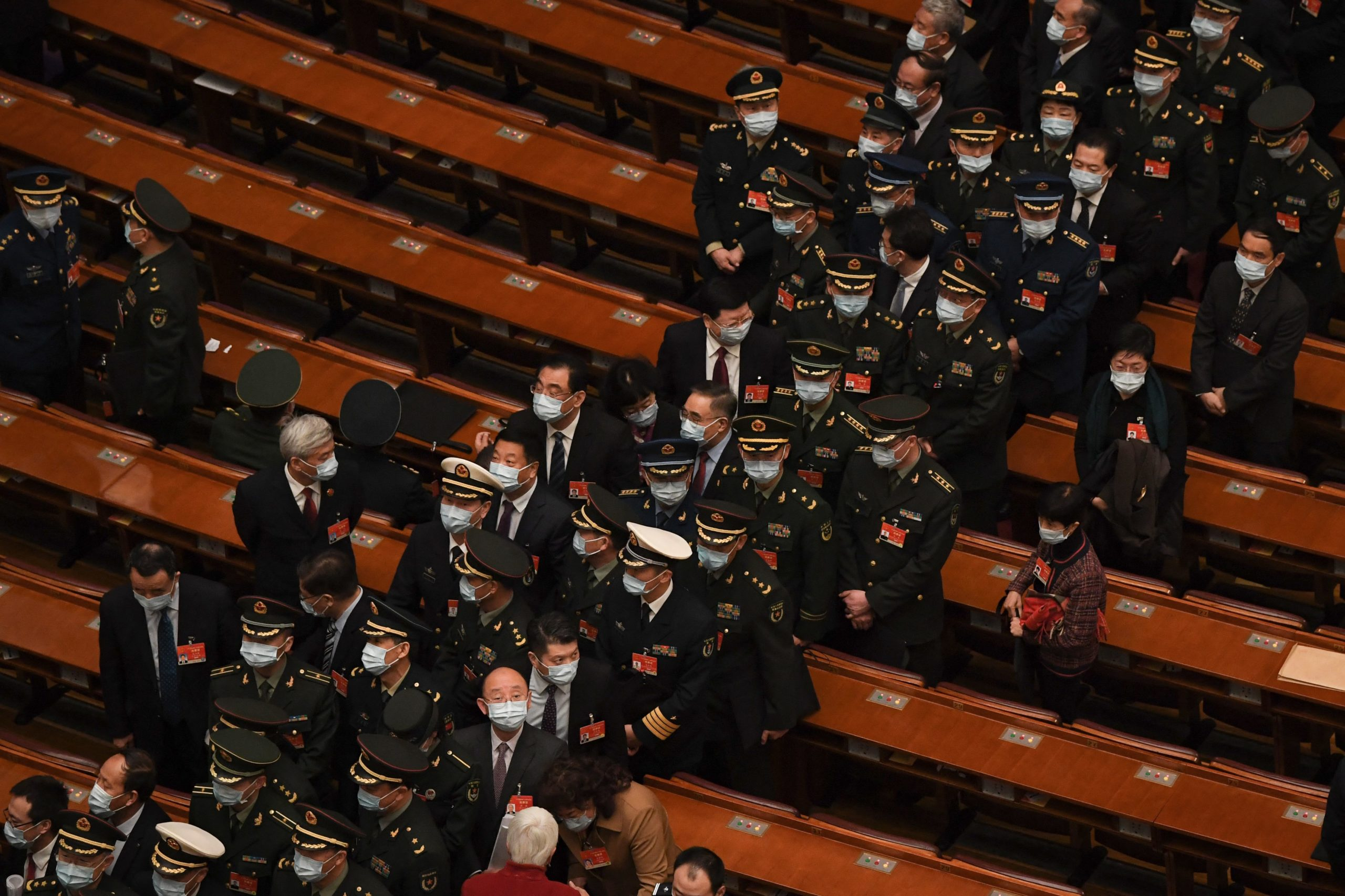 Military delegates leave after the second plenary session of the National Peoples Congress (NPC) at the Great Hall of the People in Beijing on March 8, 2021. (Photo by Noel CELIS / AFP) (Photo by NOEL CELIS/AFP via Getty Images)