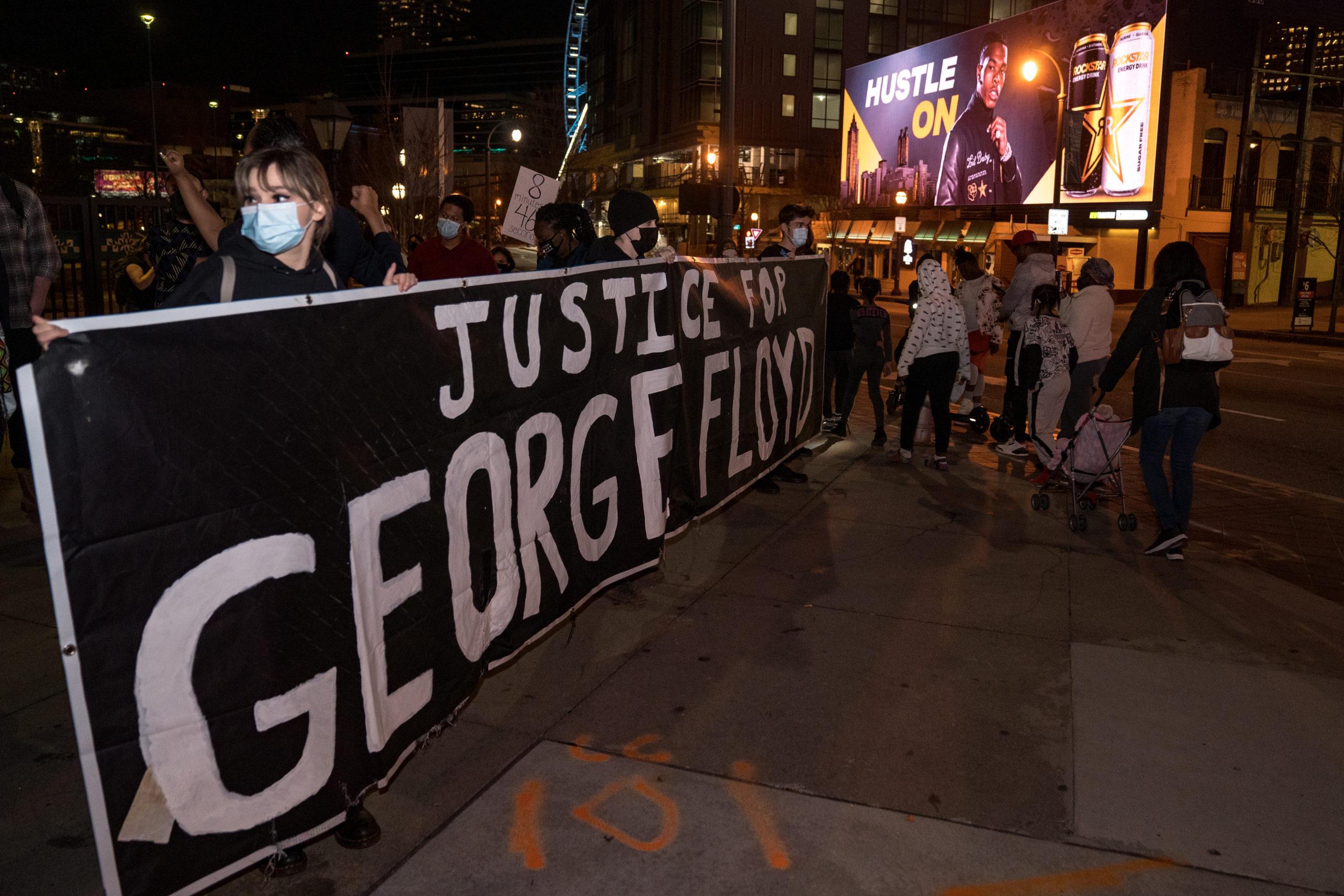 Demonstrators hold a vigil in honor of George Floyd on March 8, 2021 in Atlanta, Georgia. (Megan Varner/Getty Images)