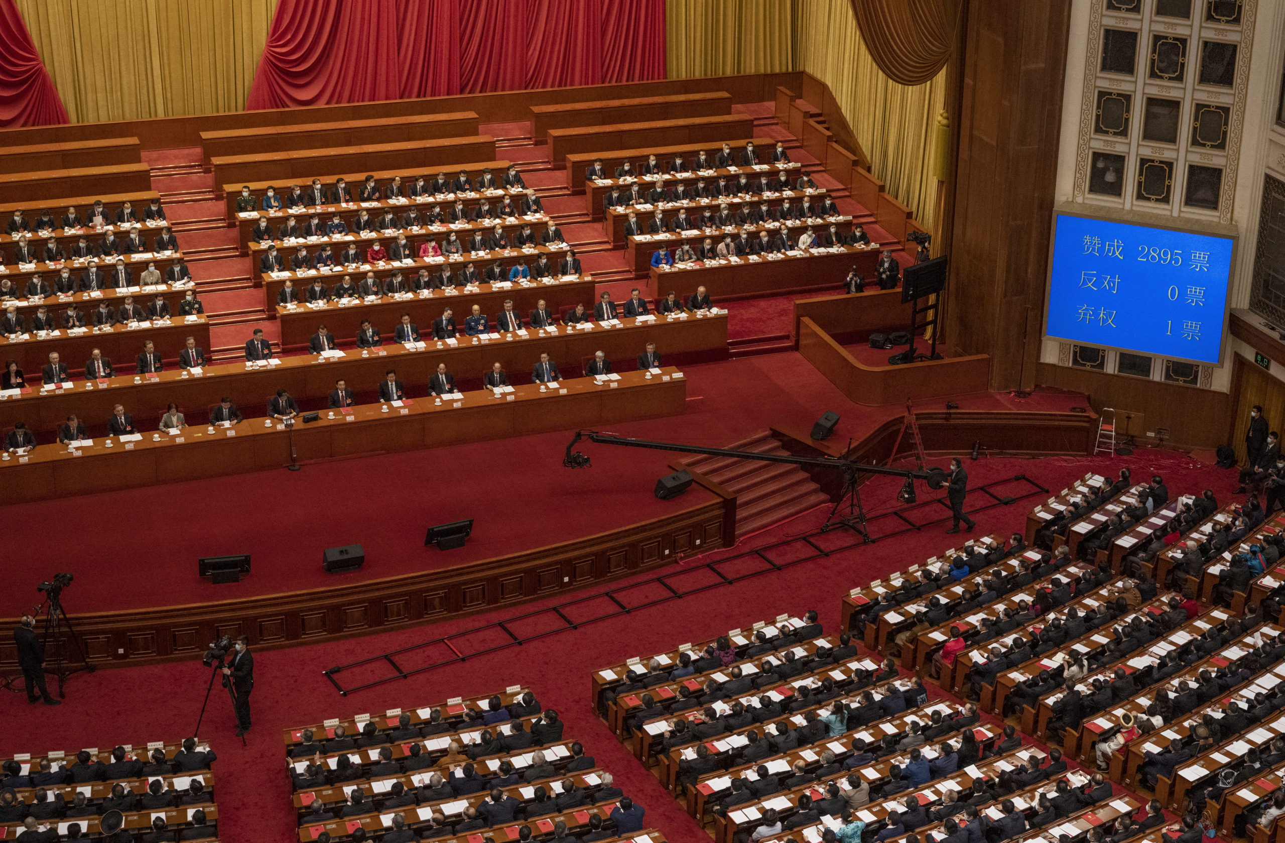 China's President Xi Jinping and lawmakers gather on March 11 in Beijing, China. (Kevin Frayer/Getty Images)