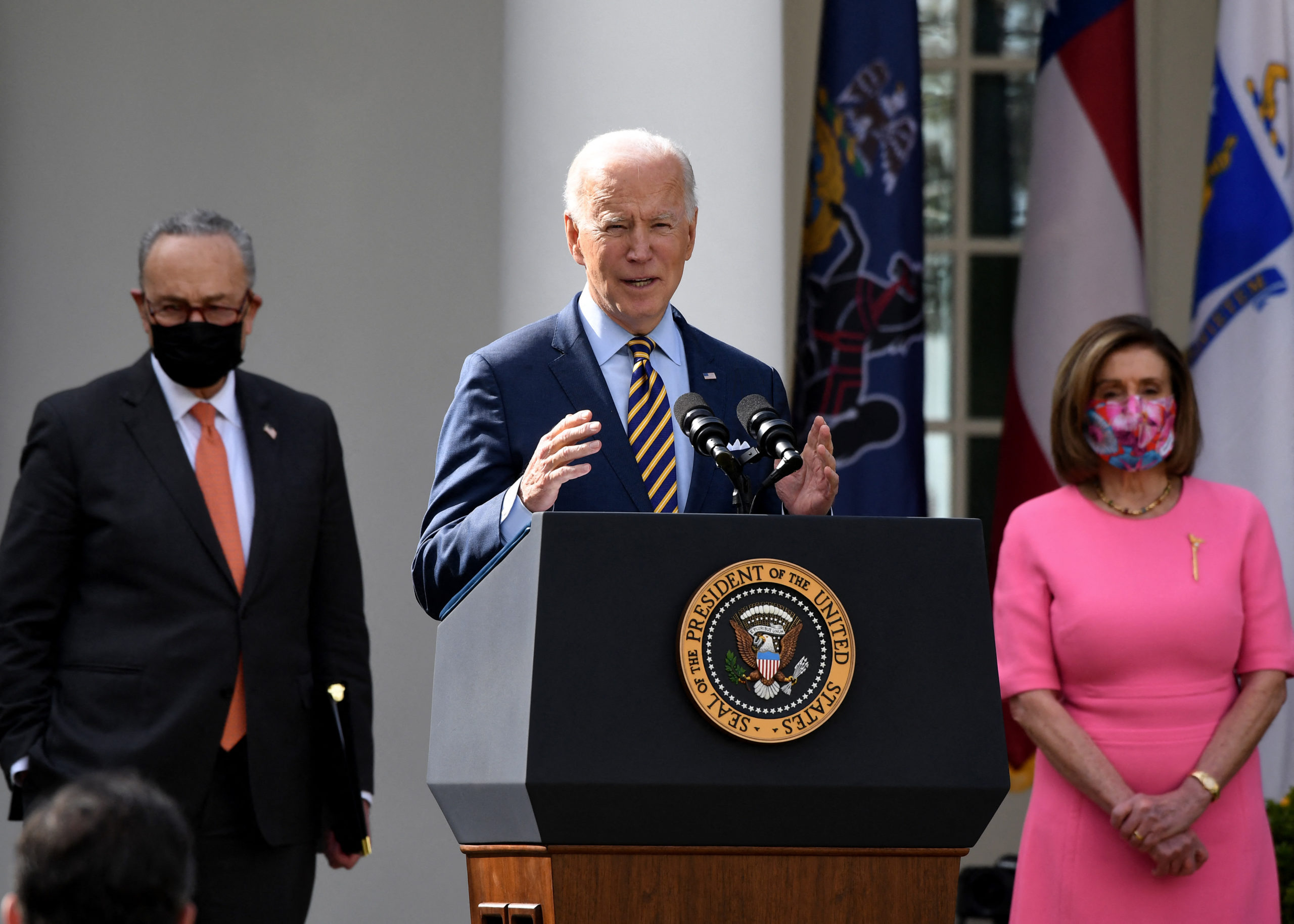 US President Joe Biden, with (L-R) Senate Majority Leader Chuck Schumer, Democrat of New York, and House Speaker Nancy Pelosi, Democrat of California, speaks about the American Rescue Plan in the Rose Garden of the White House in Washington, DC, on March 12, 2021. (Photo by OLIVIER DOULIERY / AFP) (Photo by OLIVIER DOULIERY/AFP via Getty Images)