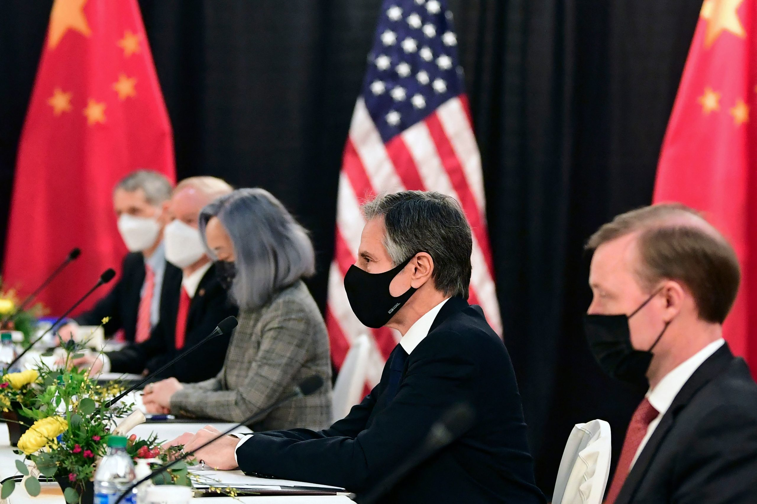 """The US delegation led by Secretary of State Antony Blinken (C), flanked by US National Security Advisor Jake Sullivan (R), face their Chinese counterparts at the opening session of US-China talks at the Captain Cook Hotel in Anchorage, Alaska on March 18, 2021. - China's actions """"threaten the rules-based order that maintains global stability,"""" US Secretary of State Antony Blinken said Thursday at the opening of a two-day meeting with Chinese counterparts in Alaska. (Photo by Frederic J. BROWN / POOL / AFP) (Photo by FREDERIC J. BROWN/POOL/AFP via Getty Images)"""