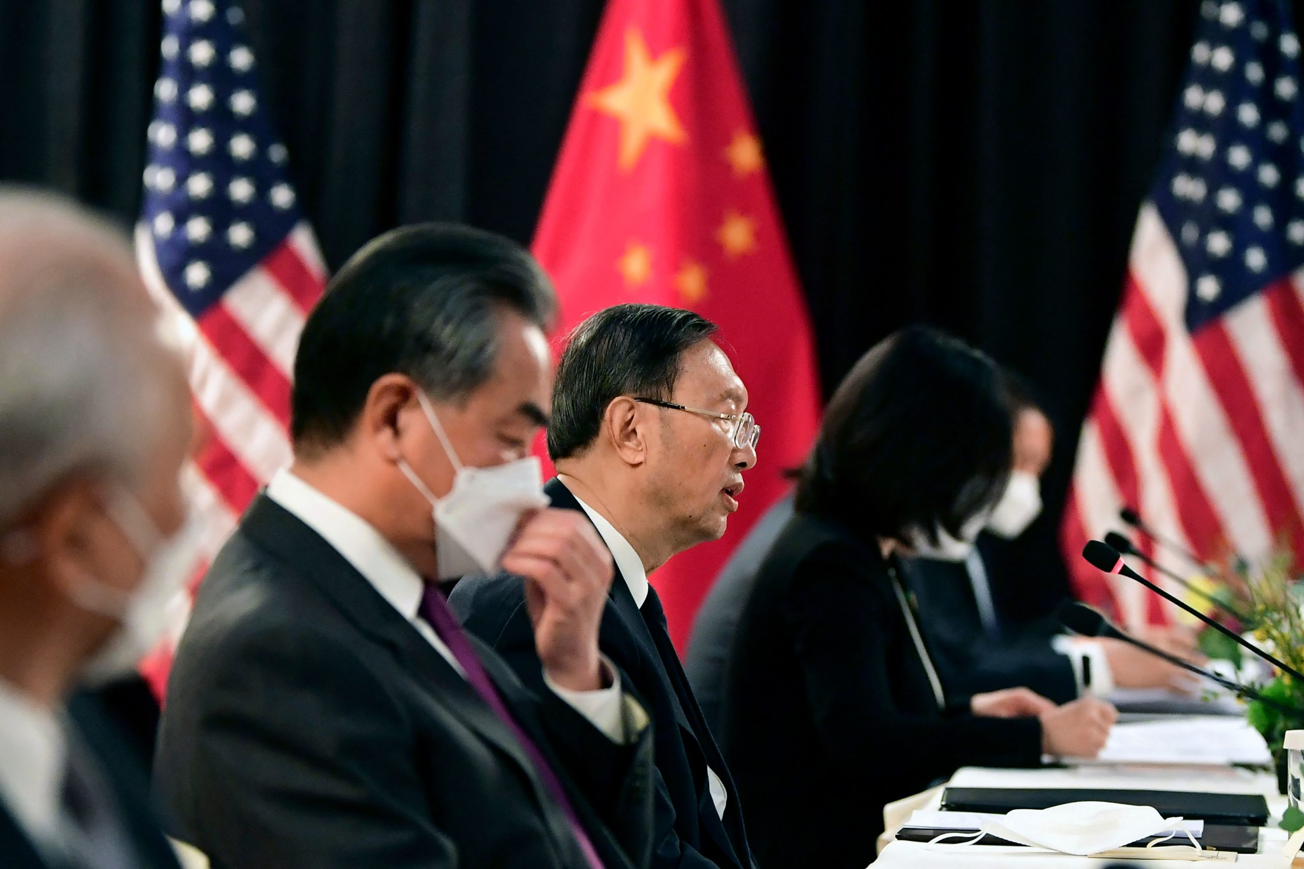 """TOPSHOT - The Chinese delegation led by Yang Jiechi (C), director of the Central Foreign Affairs Commission Office and Wang Yi (2nd L), China's Foreign Minister, speak with their US counterparts at the opening session of US-China talks at the Captain Cook Hotel in Anchorage, Alaska on March 18, 2021. - China's actions """"threaten the rules-based order that maintains global stability,"""" US Secretary of State Antony Blinken said Thursday at the opening of a two-day meeting with Chinese counterparts in Alaska. (Photo by Frederic J. BROWN / POOL / AFP) (Photo by FREDERIC J. BROWN/POOL/AFP via Getty Images)"""