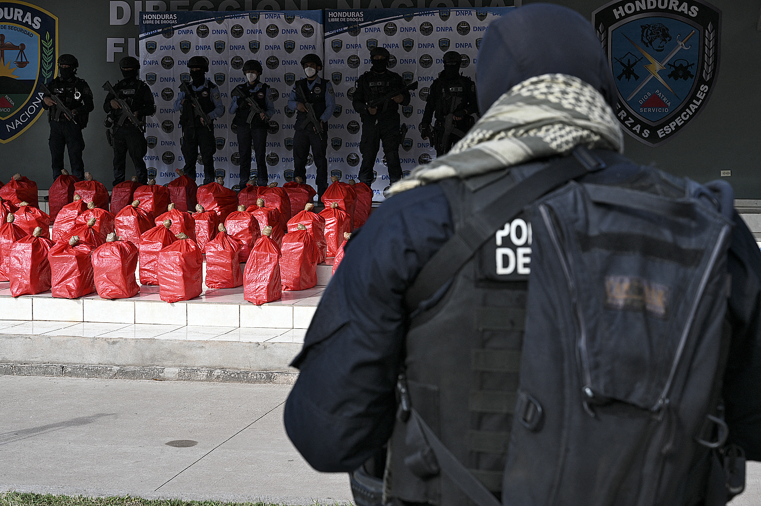 Members of the Anti-Drug National Police Directorate (DNPA) stand guard next to two tons of seized drug in Tegucigalpa on March 20, 2021. - The alleged cocaine was seized in a mountainous area in Icoteas, Limon municipality, Colon department. (Photo by Orlando SIERRA / AFP) (Photo by ORLANDO SIERRA/AFP via Getty Images)