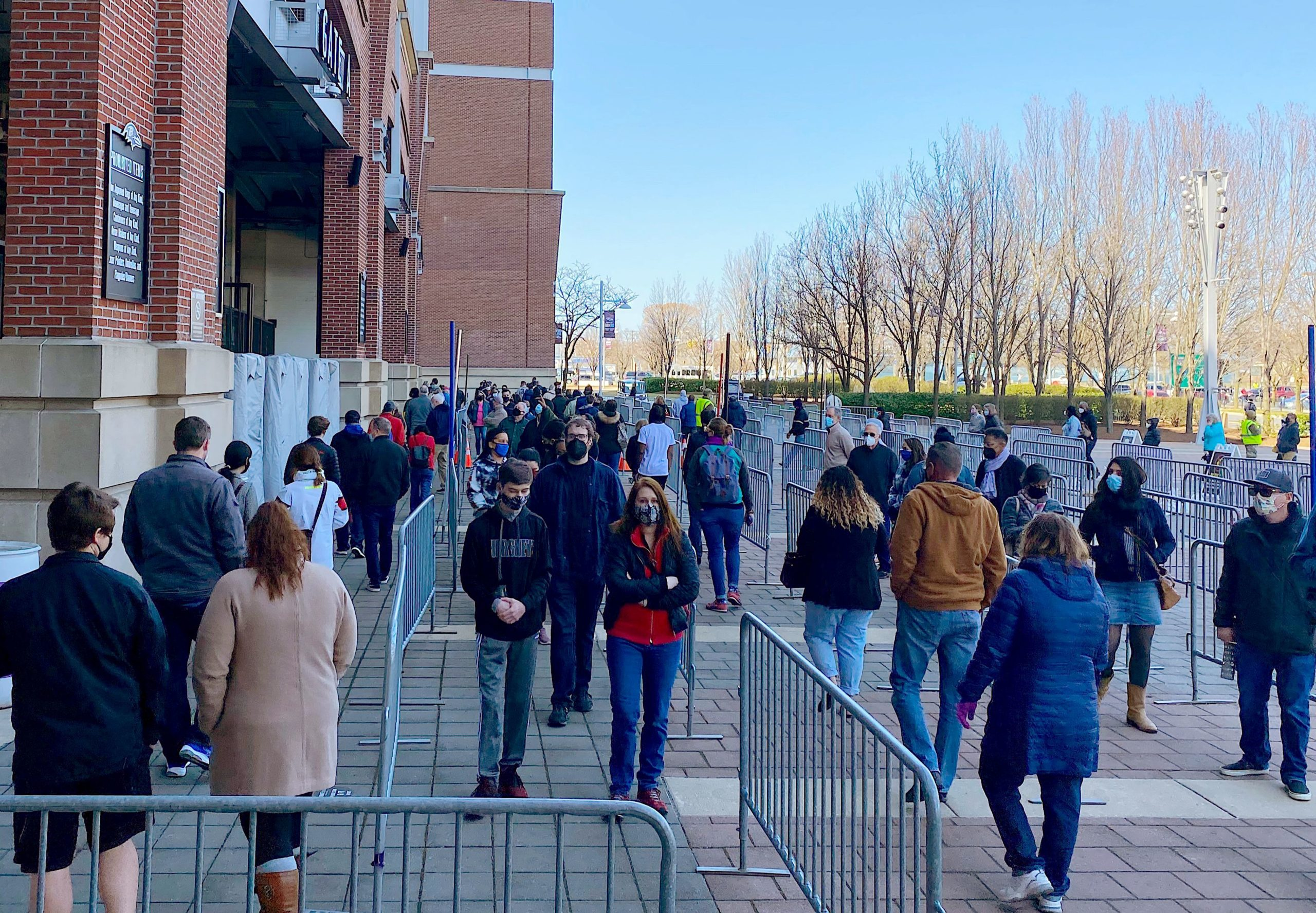 People line up at M&T Bank Stadium in Baltimore, Maryland, to get vaccinated on March 20, 2021. (ERIC BARADAT/AFP via Getty Images)