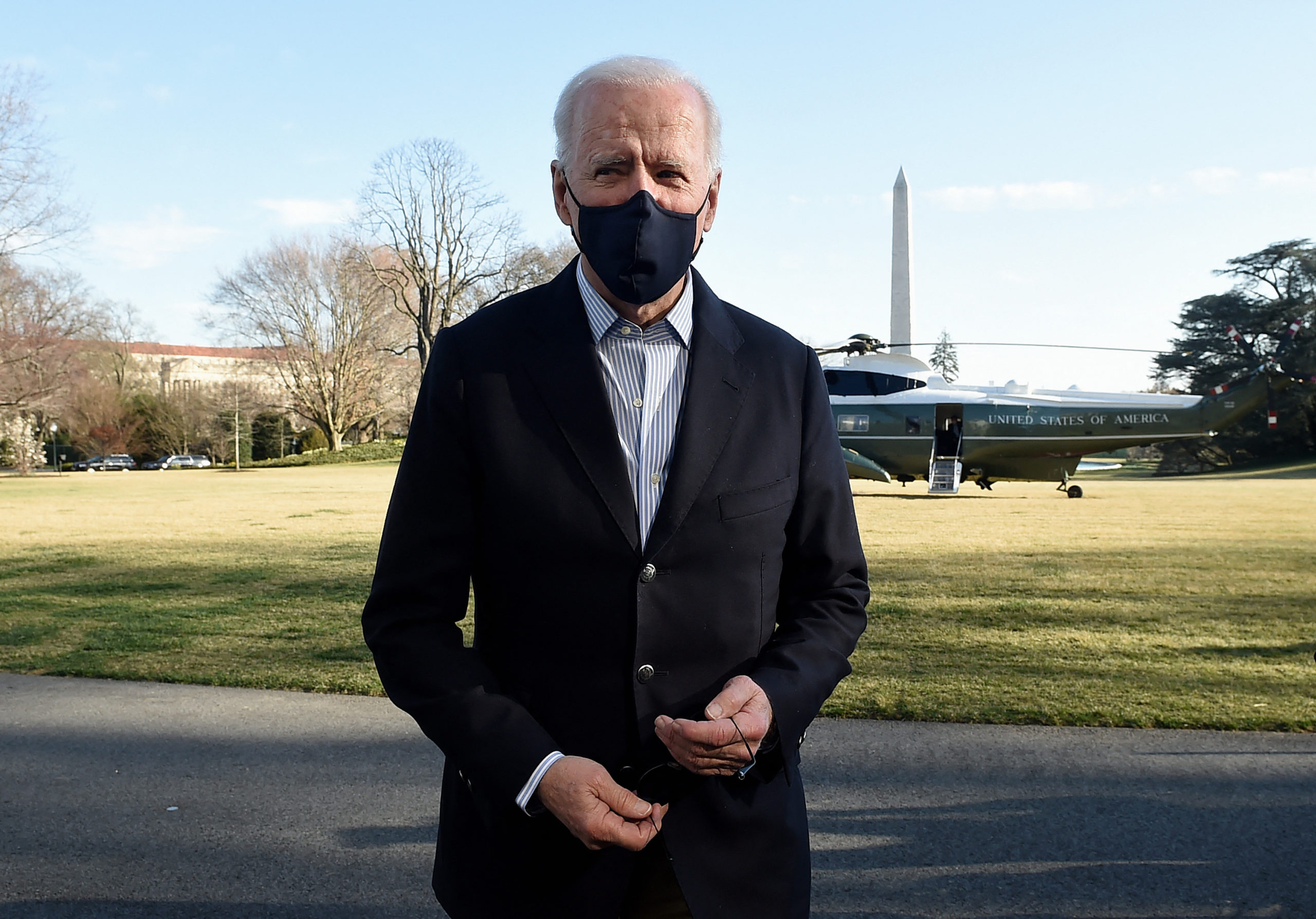 US President Joe Biden talks briefly with reporters upon his return from Camp David, Maryland to the White House in Washington, DC on March 21, 2021. (Photo by OLIVIER DOULIERY/AFP via Getty Images)