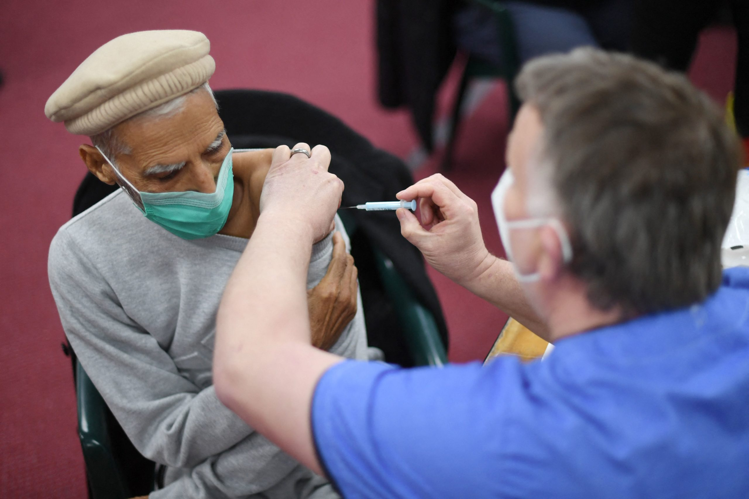 A health worker administers a dose of the AstraZeneca vaccine at a coronavirus vaccination location in London on Tuesday. (Daniel Leal-Olivas/AFP via Getty Images)