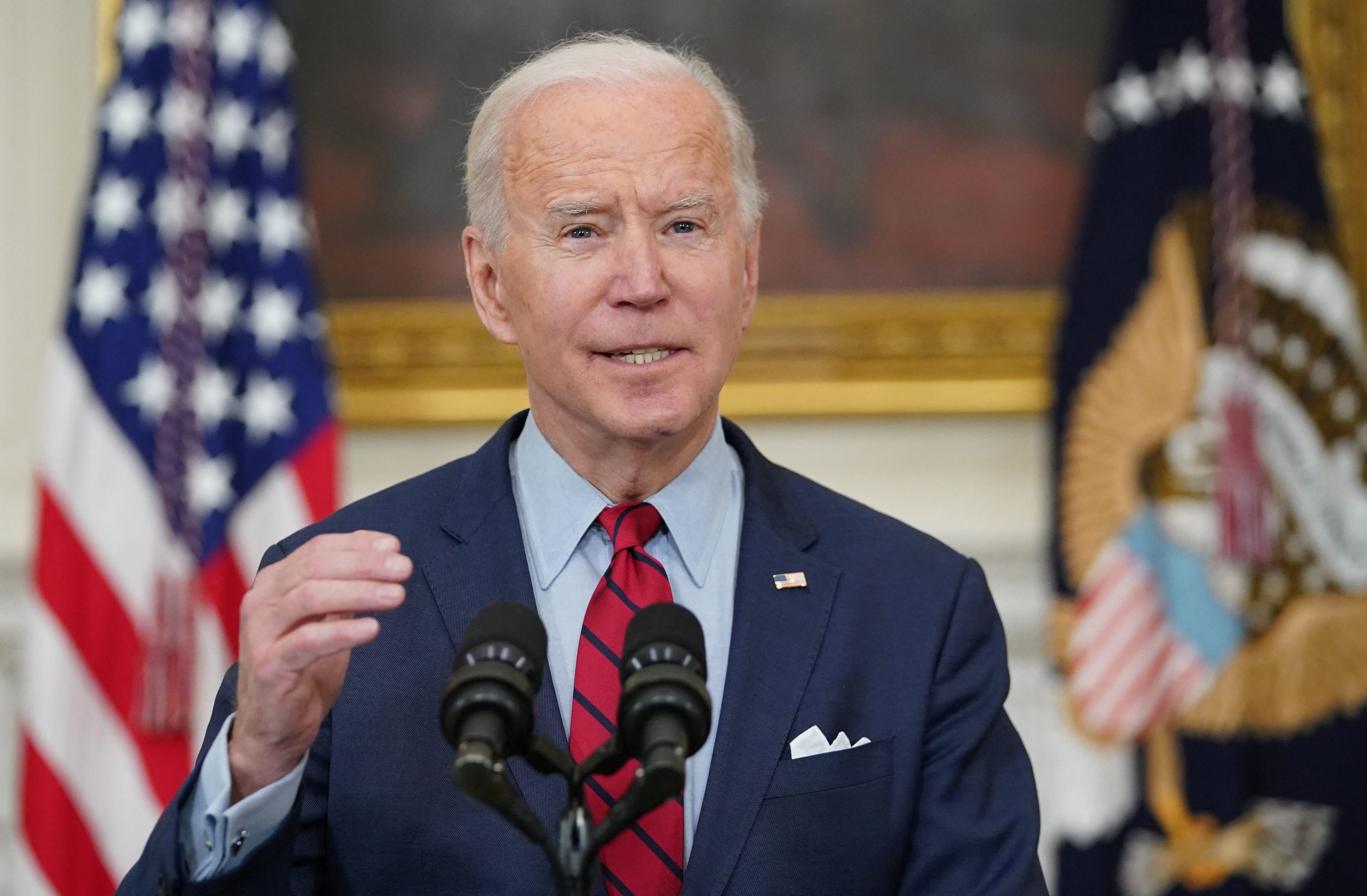 US President Joe Biden speaks about the Colorado shootings in the State Dining Room of the White House in Washington, DC, on March 23, 2021. - A 21-year-old man was charged Tuesday with gunning 10 people down in a Colorado grocery store, as America reeled from its second mass shooting in less than a week -- sparking urgent new calls for gun control. The suspect, named as Ahmad Al Aliwi Alissa, was in hospital after being shot in an exchange of fire with officers following the attack on King Soopers Supermarket in Boulder County, 30 miles (50kms) northwest of the state capital Denver, on March 22. (Photo by MANDEL NGAN/AFP via Getty Images)