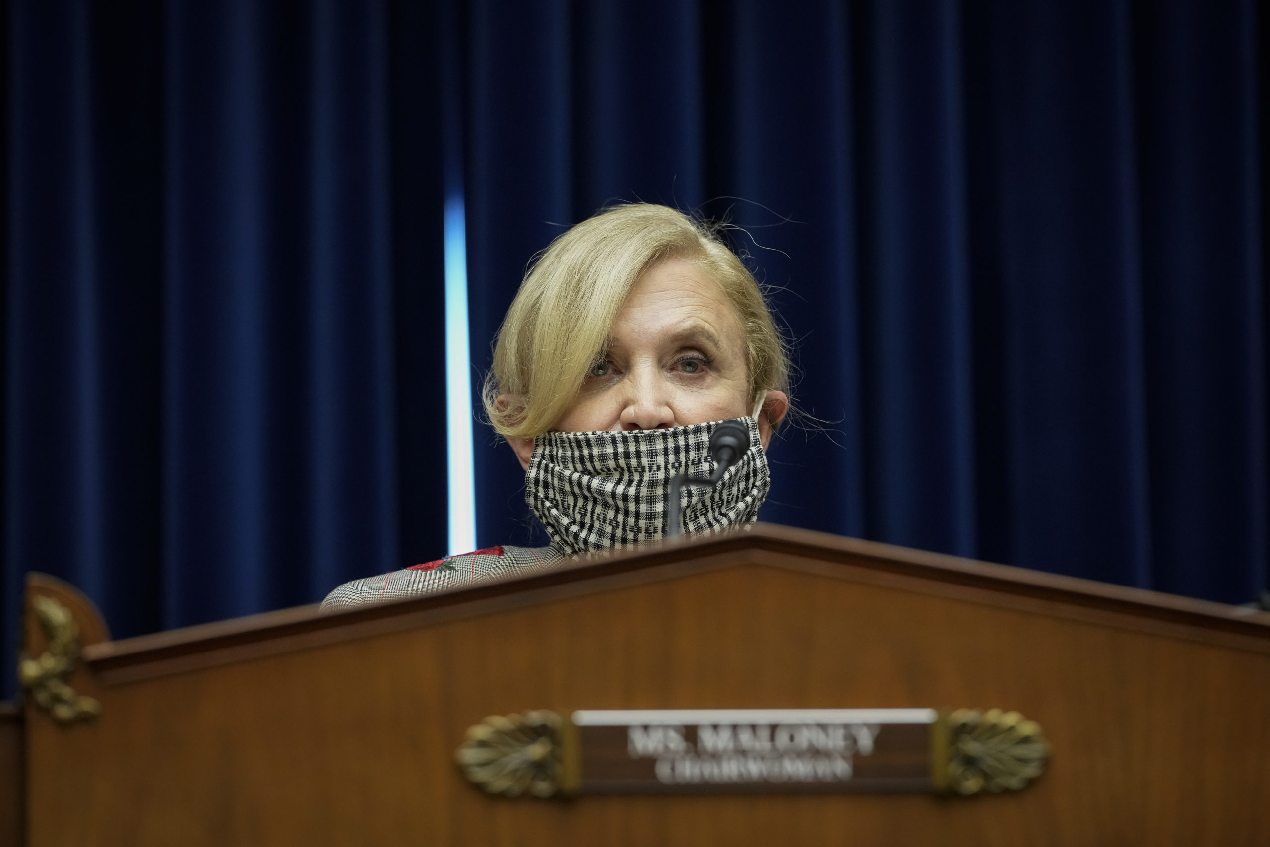 """WASHINGTON, DC - MARCH 24: Committee chairwoman Rep. Carolyn Maloney (D-NY) speaks during a House Oversight Committee hearing titled """"Honoring Equal Pay Day: Examining the Long-Term Economic Impacts of Gender Inequality"""" on Capitol Hill on March 24, 2021 in Washington, DC. (Photo by Drew Angerer/Getty Images)"""