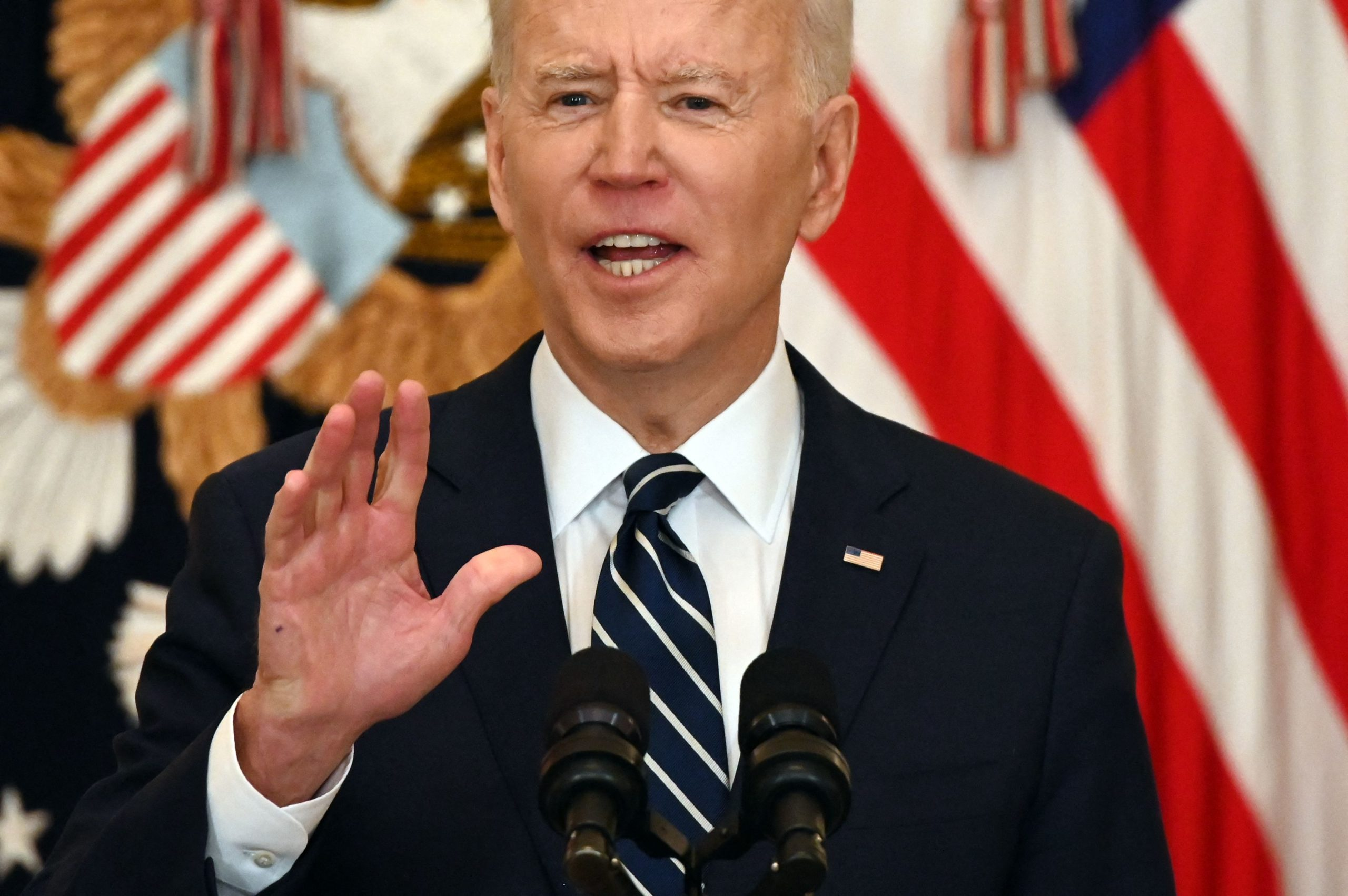 """US President Joe Biden answers a question during his first press briefing in the East Room of the White House in Washington, DC, on March 25, 2021. - Biden said Thursday that the United States will """"respond accordingly"""" if North Korea escalates its missile testing. (Photo by JIM WATSON/AFP via Getty Images)"""