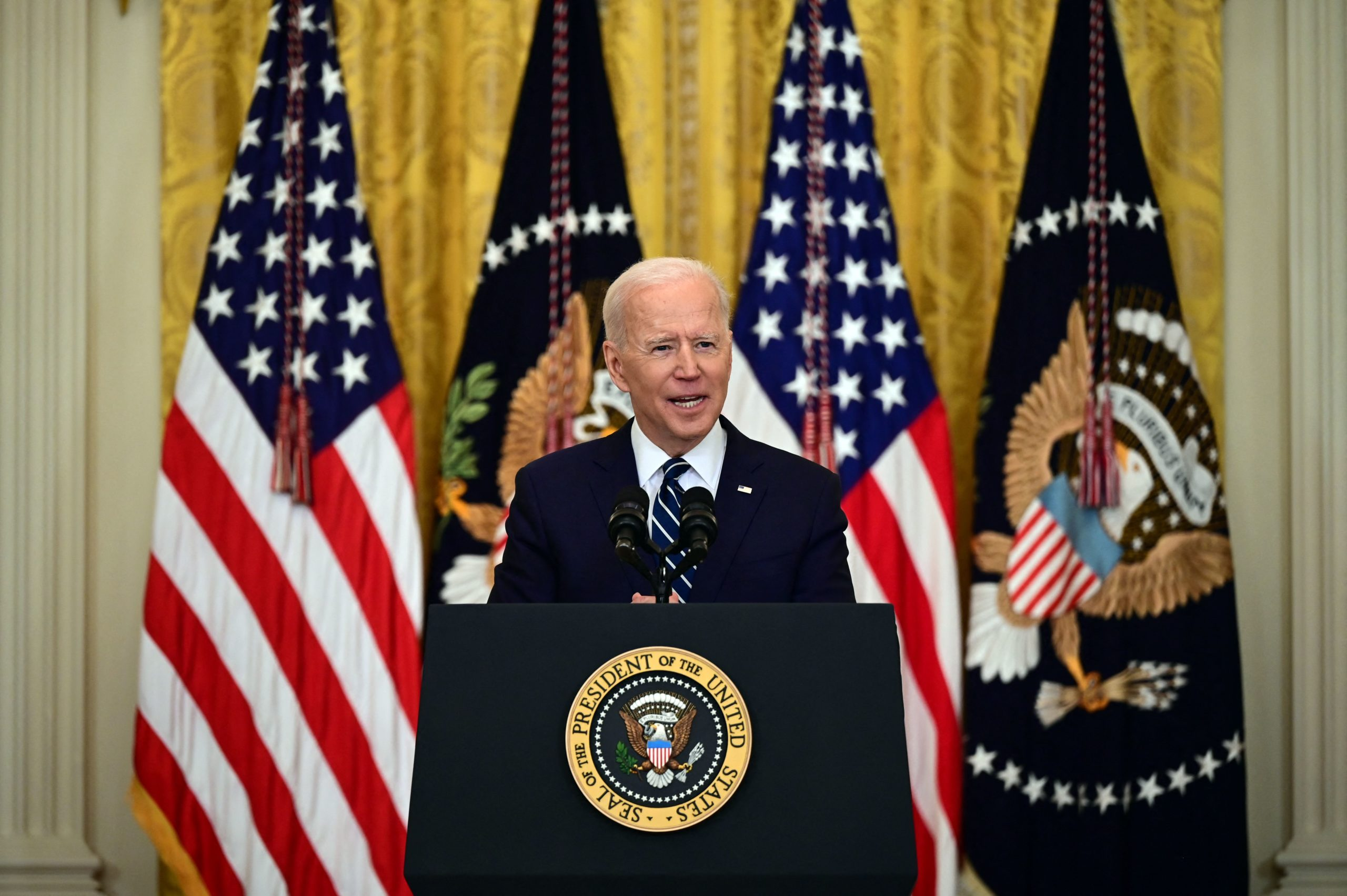 US President Joe Biden answers a question during his first press briefing in the East Room of the White House in Washington, DC, on March 25, 2021. - Biden pushed back Thursday at claims the flow of undocumented immigrants at the US southern border has reached crisis levels, saying the surge is a mostly seasonal problem that happens each year. (Photo by JIM WATSON / AFP) (Photo by JIM WATSON/AFP via Getty Images)
