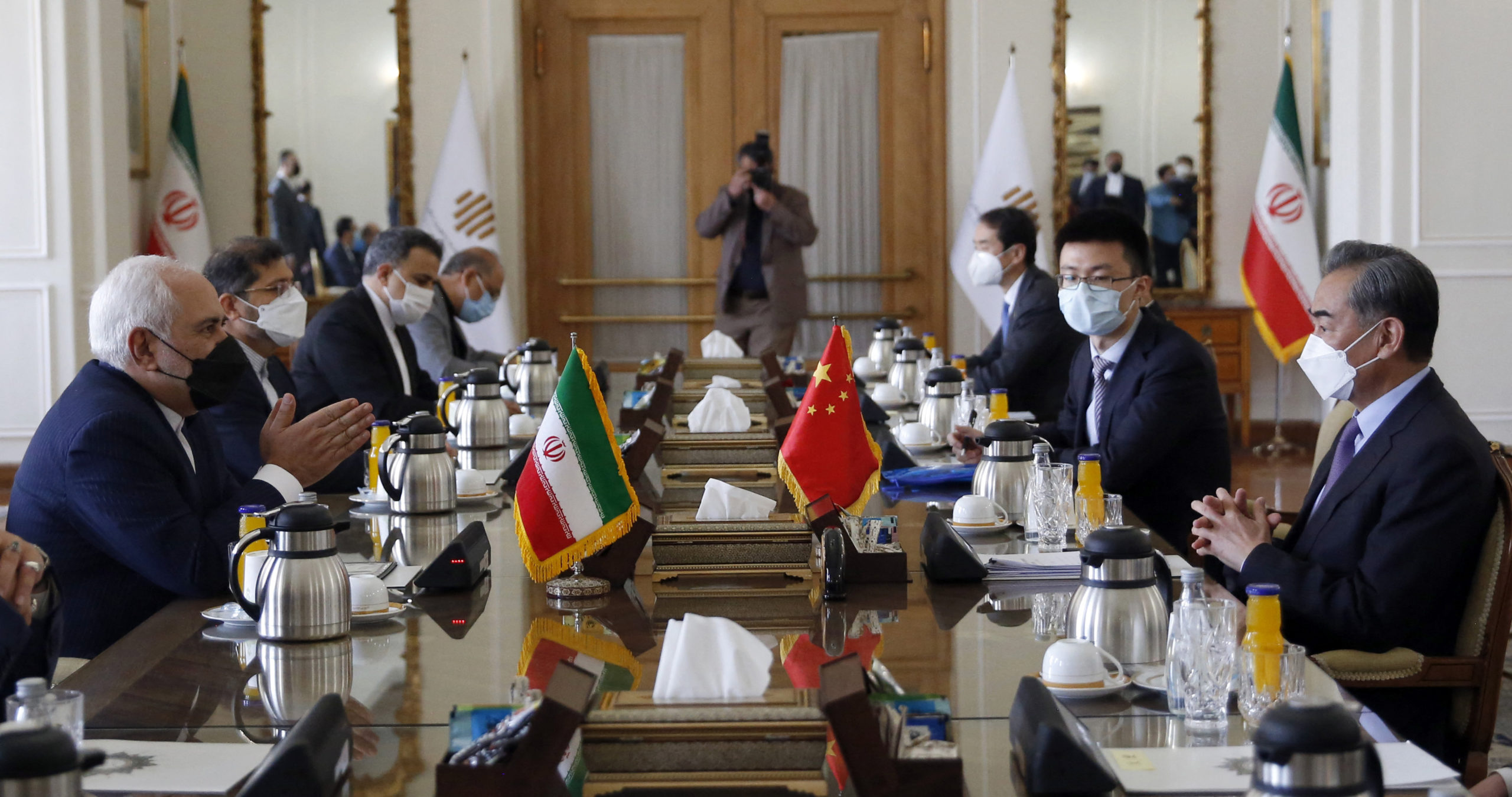 Iranian Foreign Minister Mohammad Javad Zarif (L) meets with his Chinese counterpart Wang Yi (R), in the capital Tehran, on March 27, 2021. (Photo by -/AFP via Getty Images)