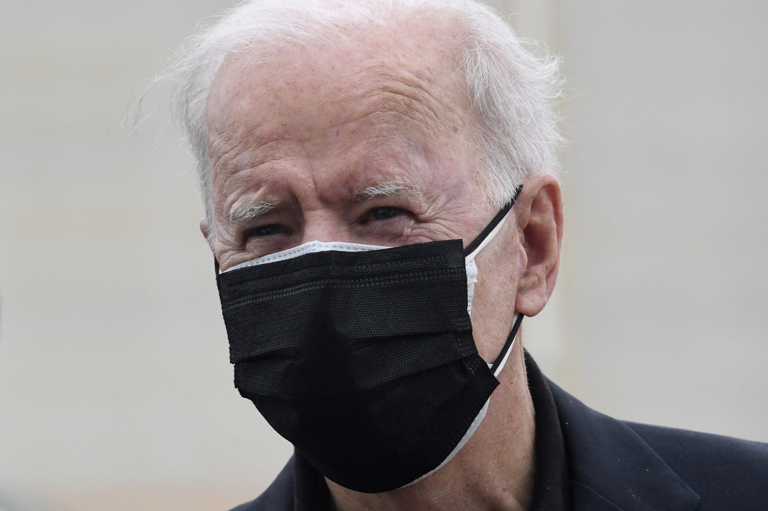 US President Joe Biden speaks to the press before boarding Air Force One after spending the weekend in Wilmington, at New Castle airport in New Castle, Delaware on March 28, 2021. (Photo by OLIVIER DOULIERY/AFP via Getty Images)