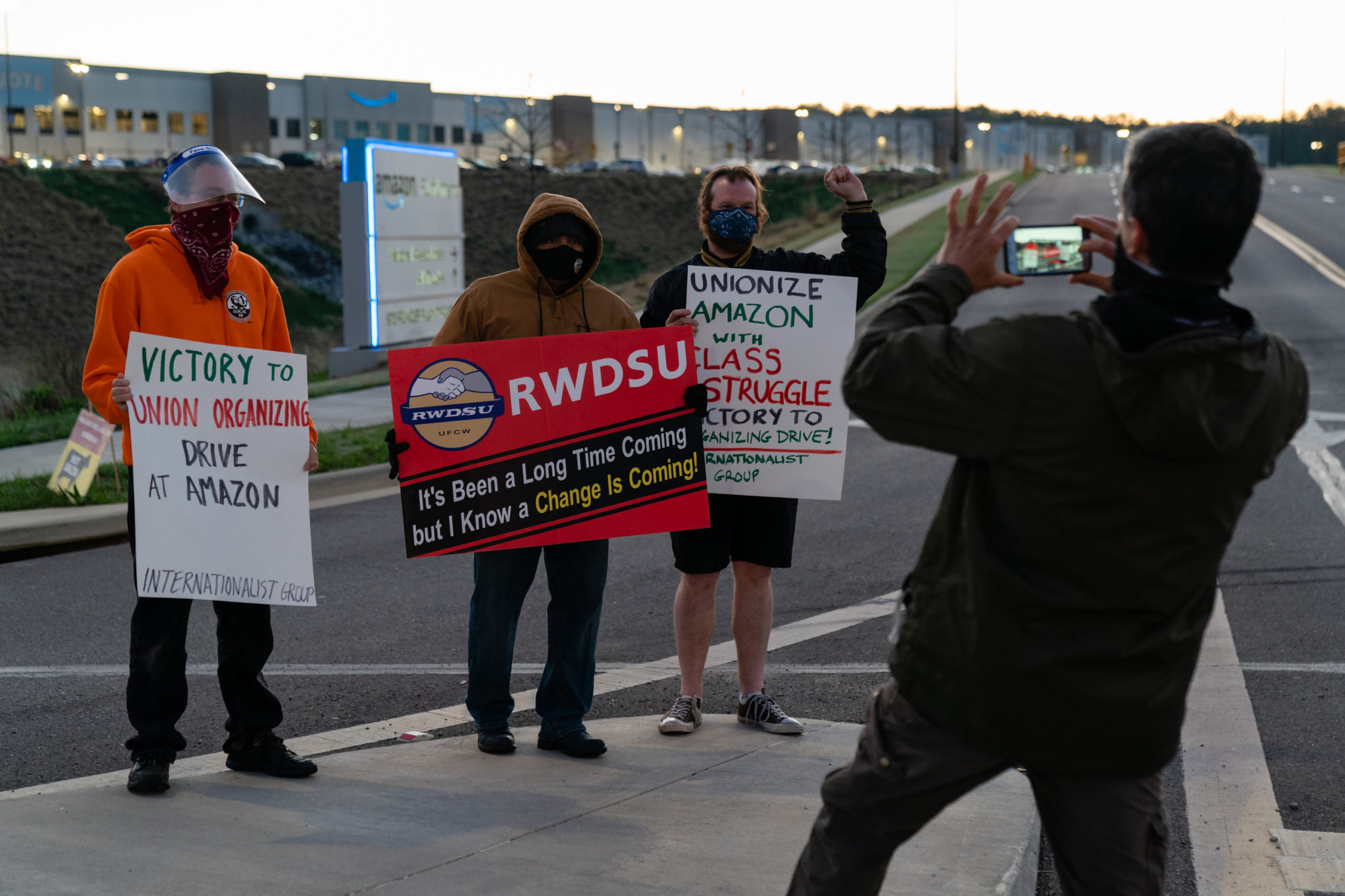 Supporters of the RWDSU unionization effort take a photo outside the Amazon fulfillment warehouse in Bessemer, Alabama on Monday. (Elijah Nouvelage/Getty Images)