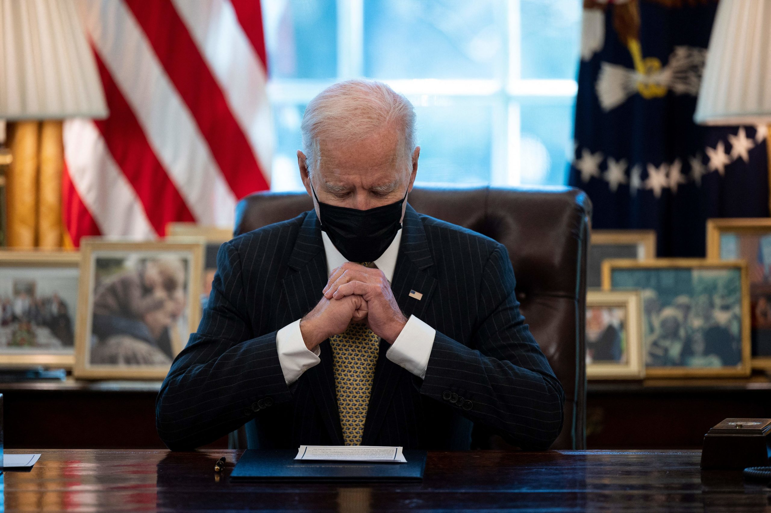 US President Joe Biden prepares to sign the Paycheck Protection Program (PPP) Extension Act of 2021 into law at the White House in Washington, DC, on March 30, 2021. (Photo by JIM WATSON/AFP via Getty Images)