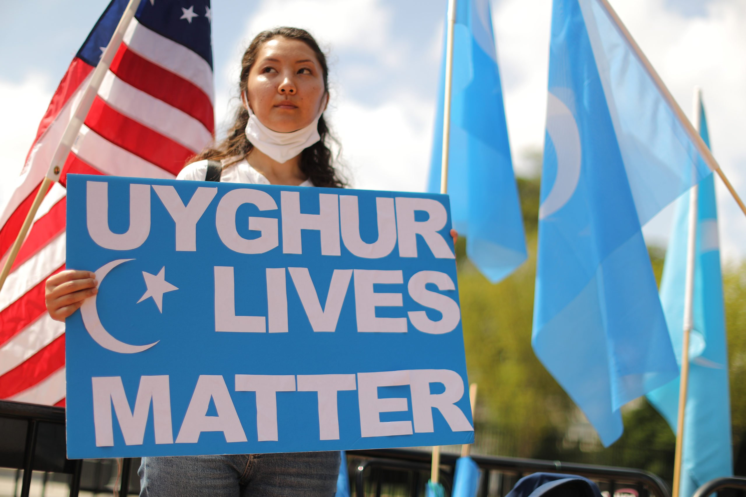 WASHINGTON, DC - AUGUST 14: Supporters and members of the East Turkistan National Awakening Movement rally outside the White House to urge the United States to end trade deals with China and take action to stop the oppression of the Uyghur and other Turkic peoples August 14, 2020 in Washington, DC. The ETNAM and East Turkistan Government in Exile (ETGE) groups submitted evidence to the international criminal court, calling for an investigation into senior Chinese officials, including Xi Jinping, for genocide and crimes against humanity. (Photo by Chip Somodevilla/Getty Images)