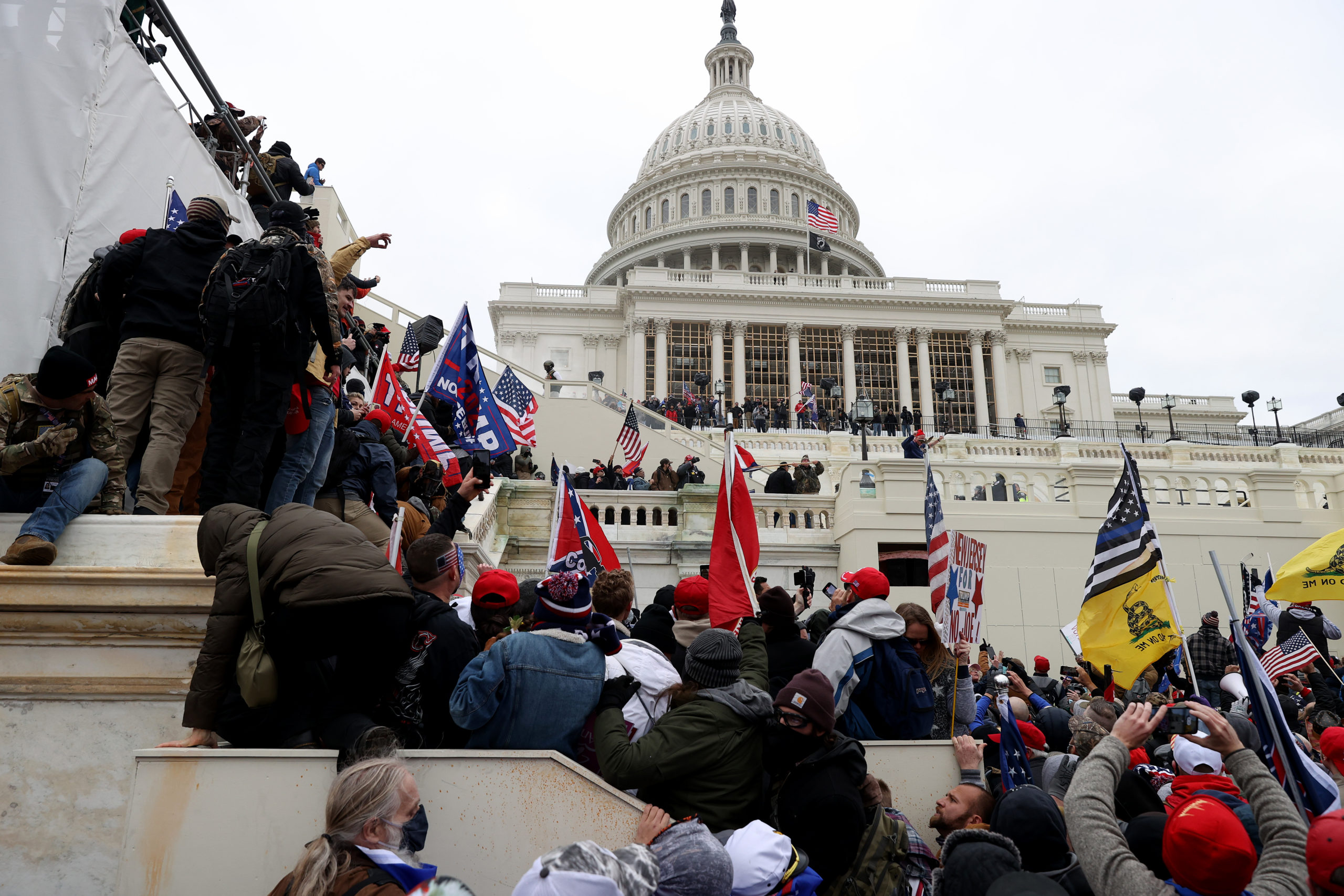 Rioters gather outside the U.S. Capitol on January 6. Many sought to stop Congress from certifying President Joe Biden's electoral victory. (Tasos Katopodis/Getty Images)
