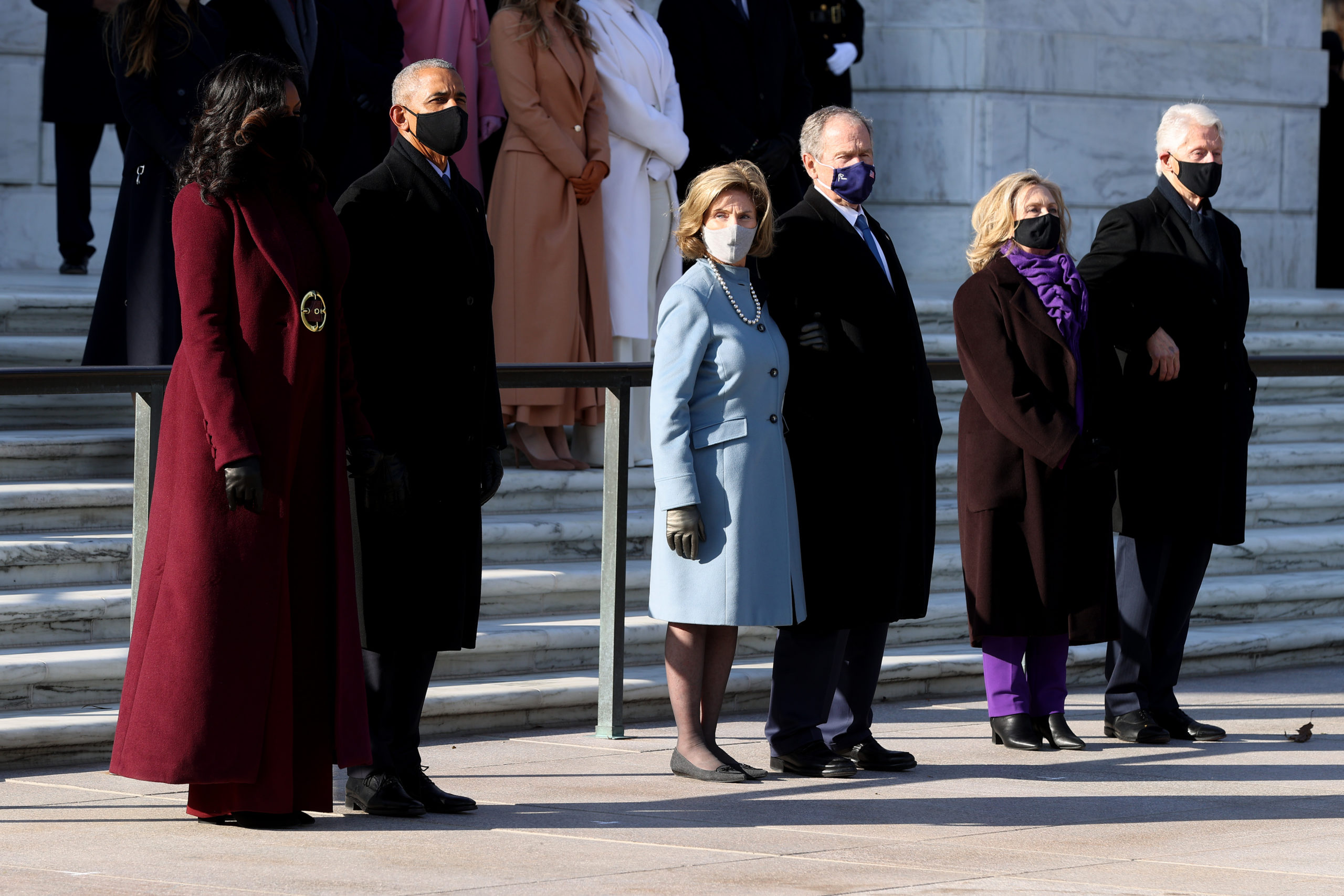 President Barack Obama, Michelle Obama, and President George W. Bush and Laura Bush, and President Bill Clinton and former Secretary of State Hillary Clinton attend a wreath-laying ceremony at the Tomb of the Unknown Soldier after President Joe Biden's Presidential inauguration. (Chip Somodevilla/Getty Images)