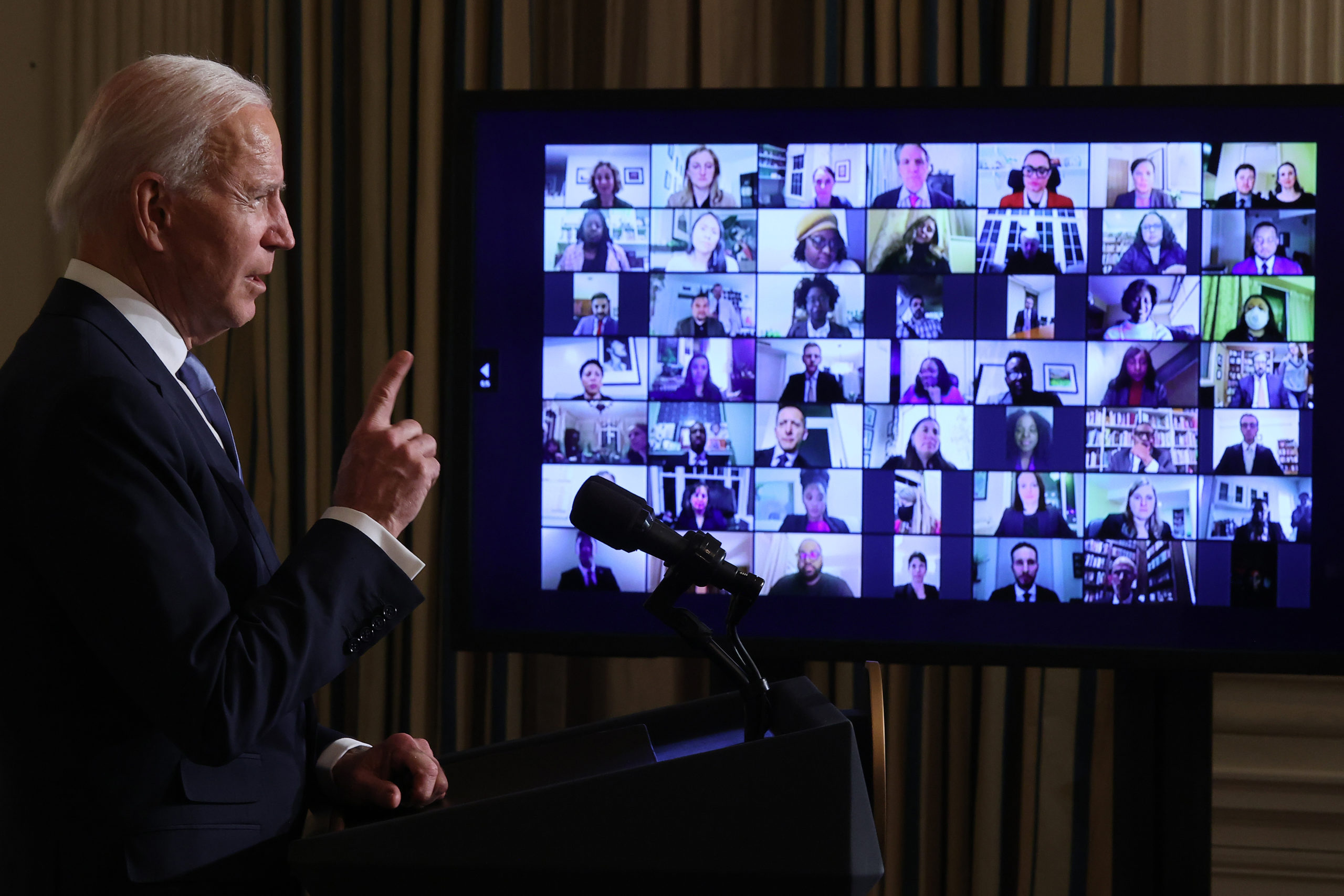 WASHINGTON, DC - JANUARY 20: U.S. President Joe Biden conducts a virtual swearing in ceremony for members of his new administration via Zoom just hours after his inauguration in the State Dining Room at the White House January 20, 2021 in Washington, DC. Biden became the 46th president of the United States earlier today during the ceremony at the U.S. Capitol. (Photo by Chip Somodevilla/Getty Images)