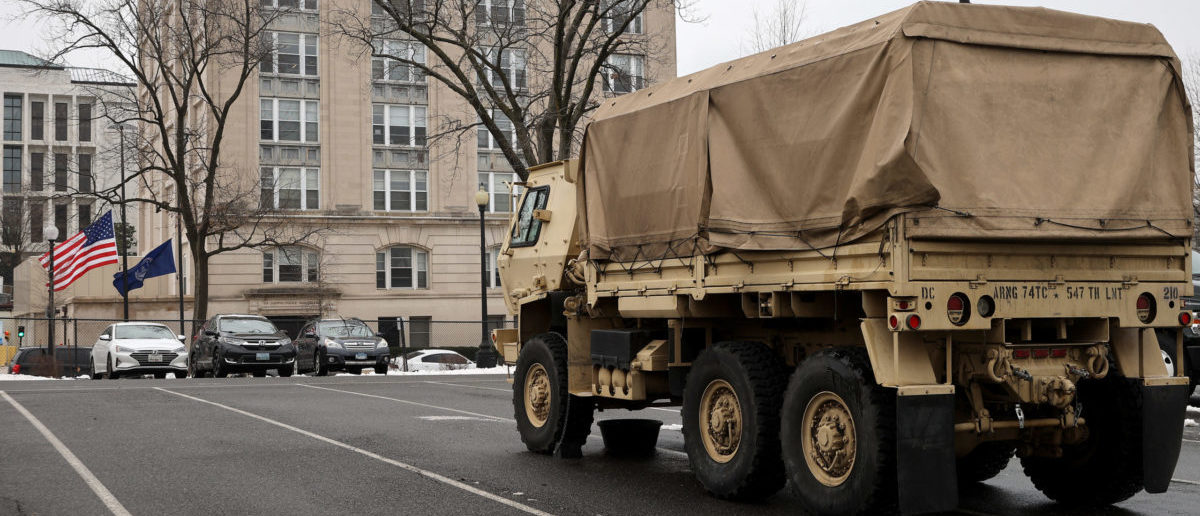 WASHINGTON, DC - FEBRUARY 19: An Army National Guard truck is parked in a lot across from the United States Capitol Police headquarters on February 19, 2021 in Washington, DC. The Capitol Police announced Thursday that it has suspended six officers with pay and placed an additional 29 officers under investigation for their actions during the January 6 insurrectionist attack on the Capitol, which resulted in Officer Brian Sicknick's death. The former Capitol Police chief and the former House and Senate Sergeants at Arms have been called to testify before the Senate Homeland Security Committee next week. (Photo by Chip Somodevilla/Getty Images)