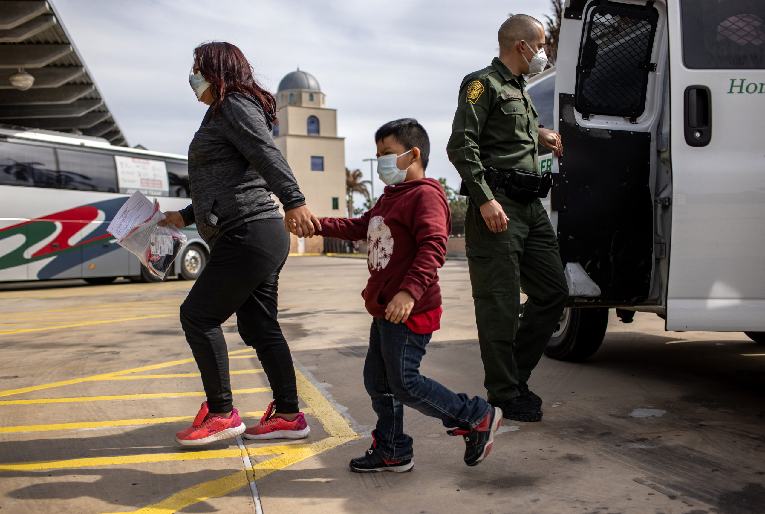 BROWNSVILLE, TEXAS - FEBRUARY 26: Central American asylum seekers arrive to a bus station while being released by U.S. Border Patrol agents on February 26, 2021 in Brownsville, Texas. U.S. immigration authorities are now releasing many asylum seeking families after detaining them while crossing the U.S.-Mexico border. The immigrant families are then free to travel to destinations throughout the U.S. while awaiting asylum hearings. (Photo by John Moore/Getty Images)