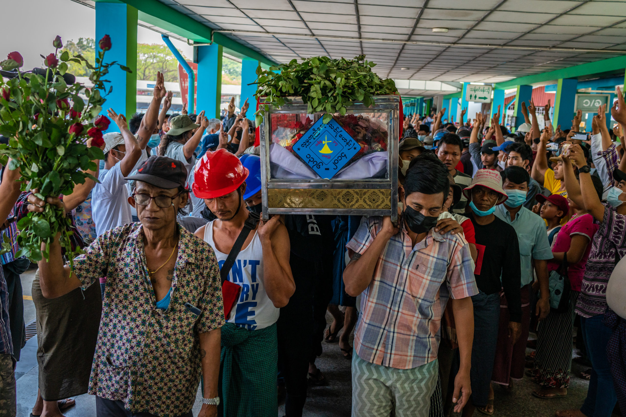 Relatives carry a coffin containing the body of Ko Phoe Chit, 22, during a funeral for protesters who were shot dead in clashes with military and police on March 05, 2021 at the Yay Way cemetery in Yangon, Myanmar. (Photo by Stringer/Getty Images)